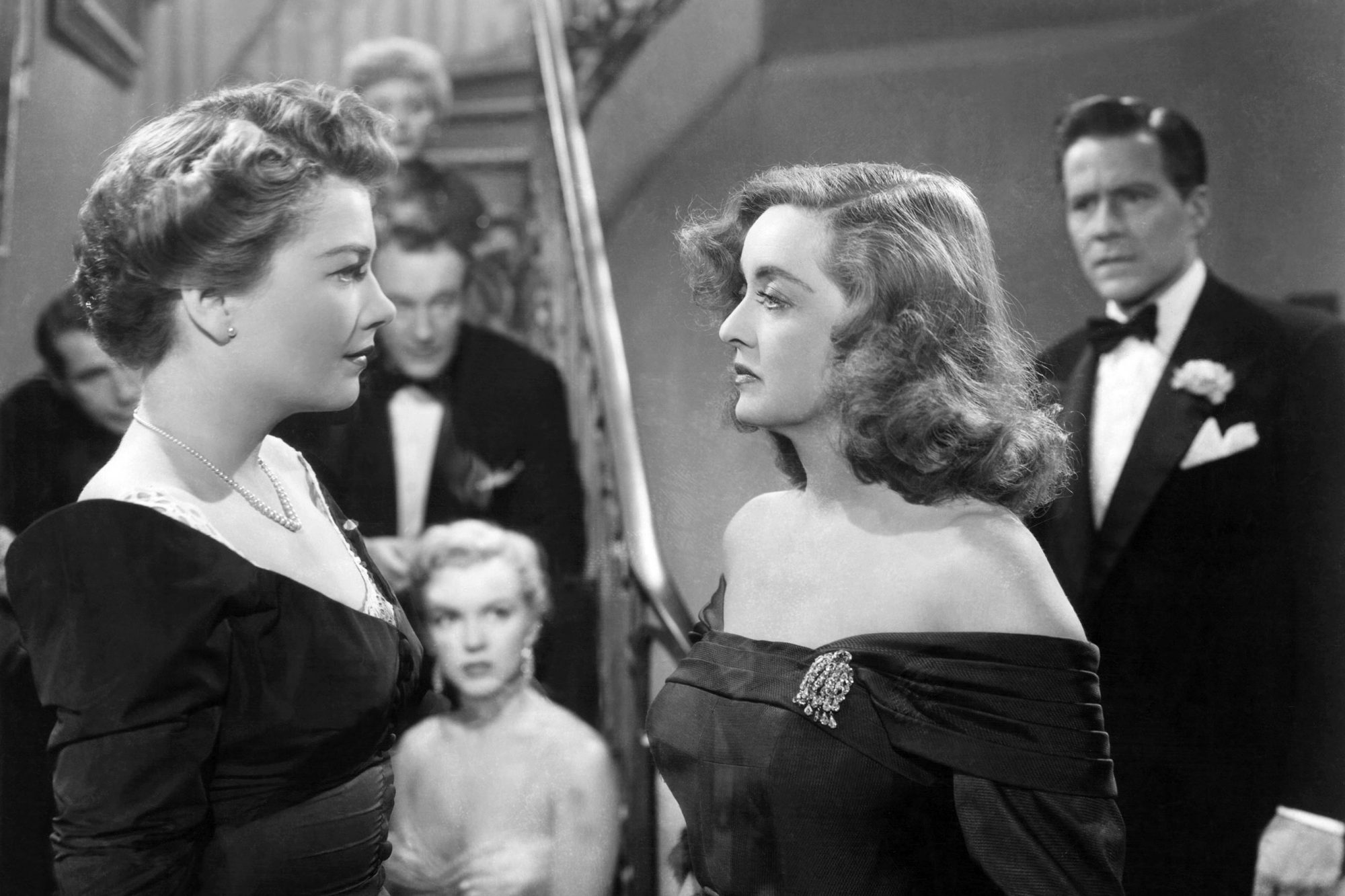 ALL ABOUT EVE, front, from left: Anne Baxter, Bette Davis; background: Gary Merrill, Celeste Holm,