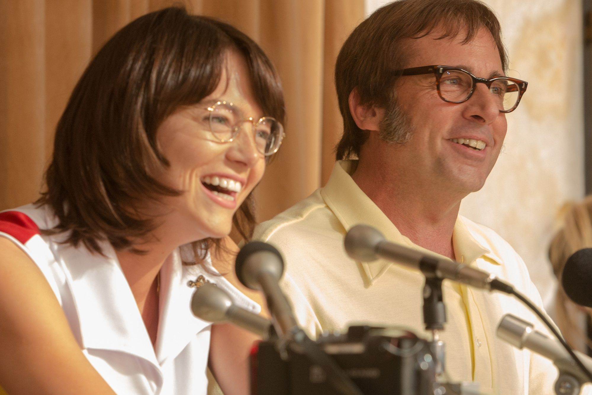 "Emma Stone as ""Billie Jean King"" and  Steve Carell as ""Bobby Rig"