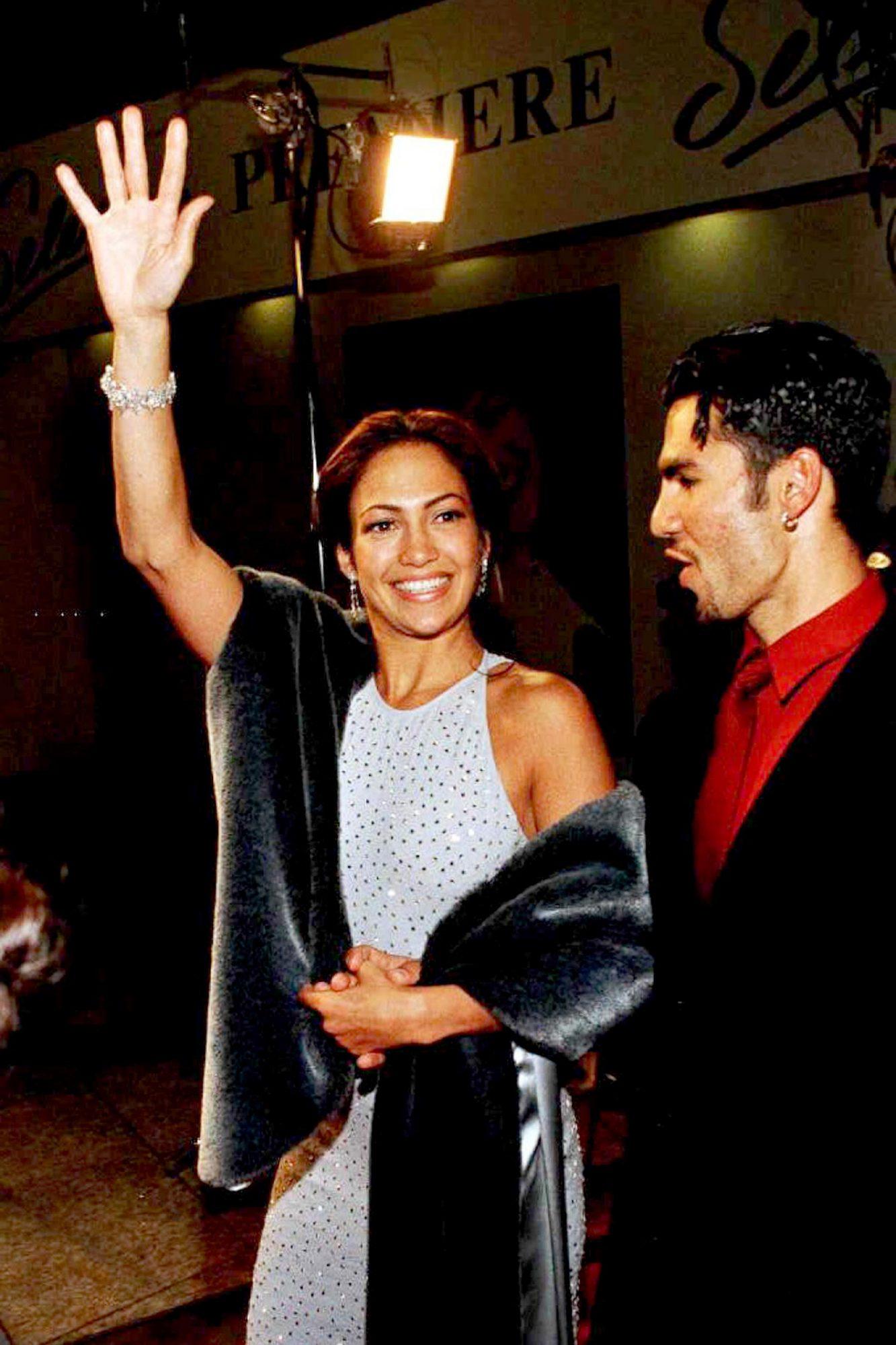 Actress Jennifer Lopez (L) waves to fans as she ar