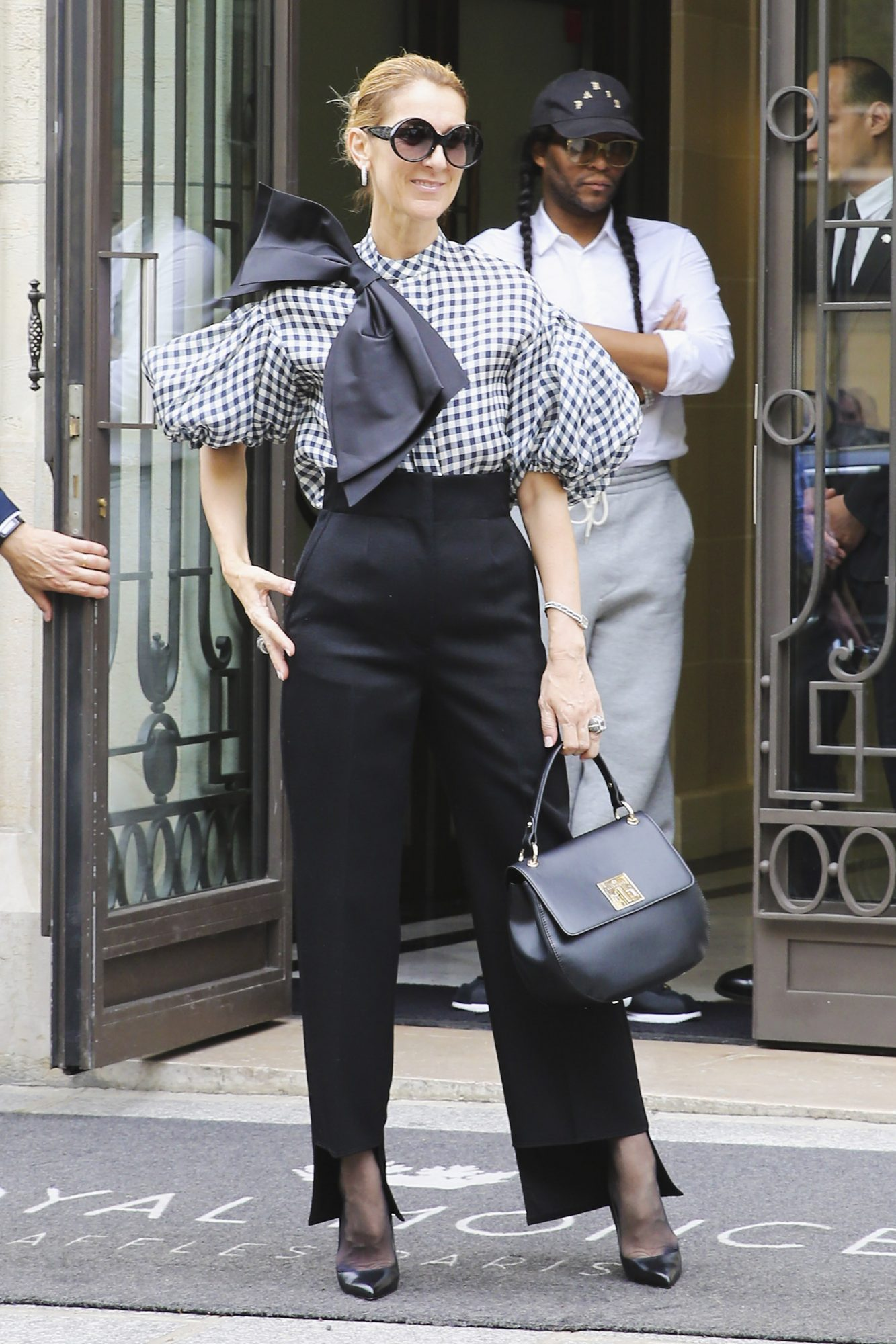PARIS, FRANCE - JULY 06: Singer Celine Dion seen wearing Dice Kayek top, Celine pants, Tom Ford shoes and bag from Celine Dion Collection on July 6, 2017 in Paris, France. (Photo by Mireya Acierto/GC Images)