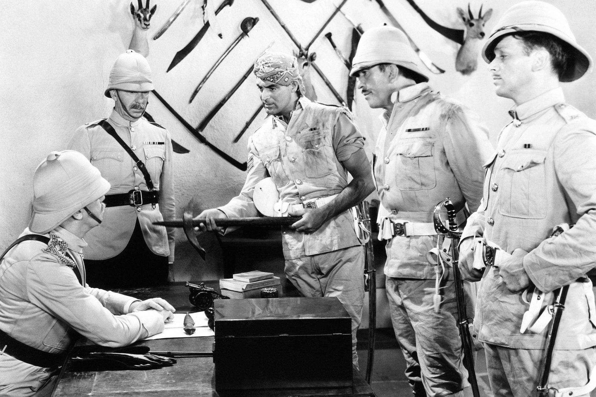 GUNGA DIN, standing from left: Lumsden Hare, Cary Grant, Victor McLaglen, Douglas Fairbanks Jr.,