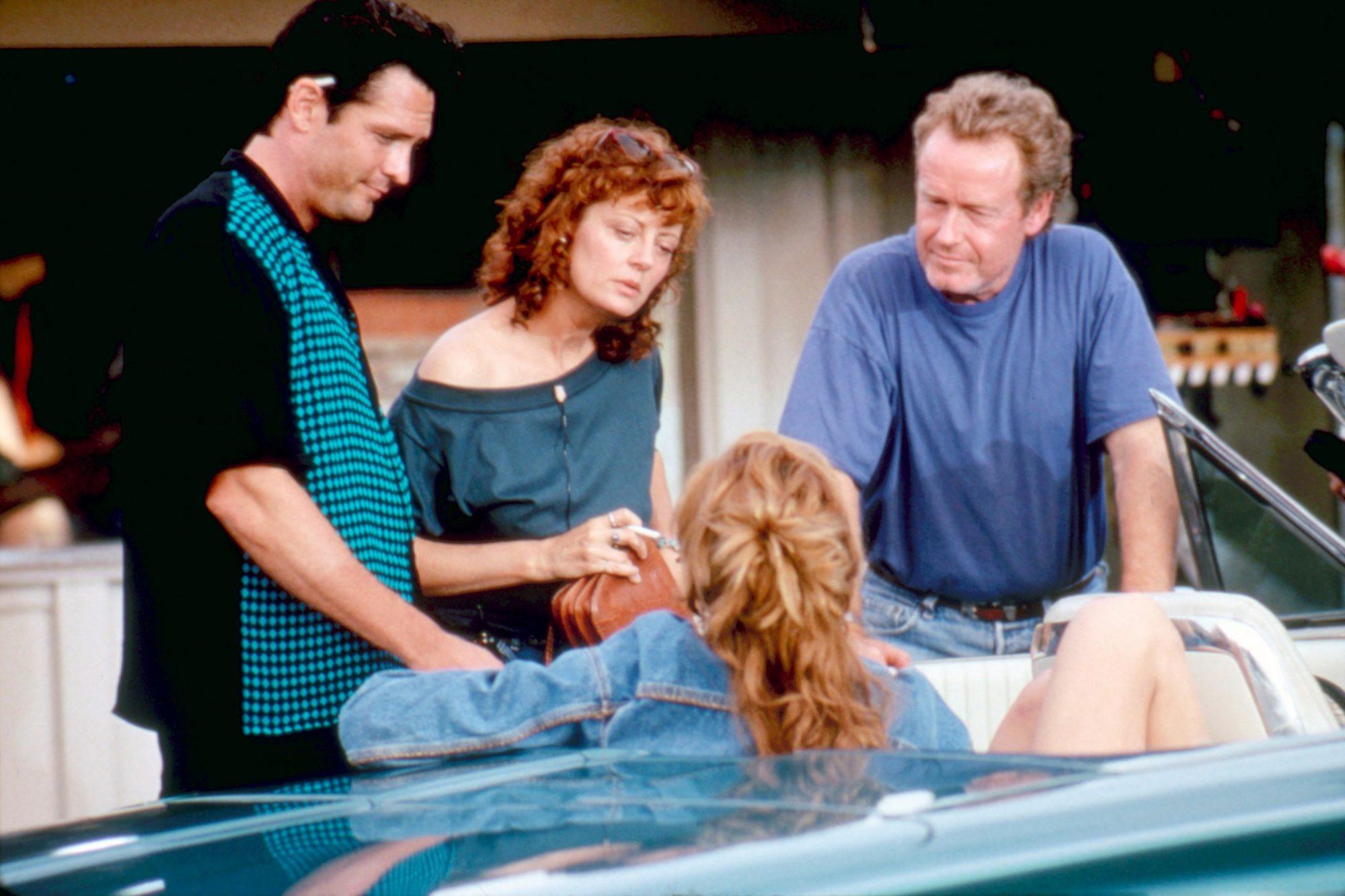 THELMA and LOUISE  Michael Madsen, Susan Sarandon, Geena Davis, director Ridley Scott, on set, 1991. ©