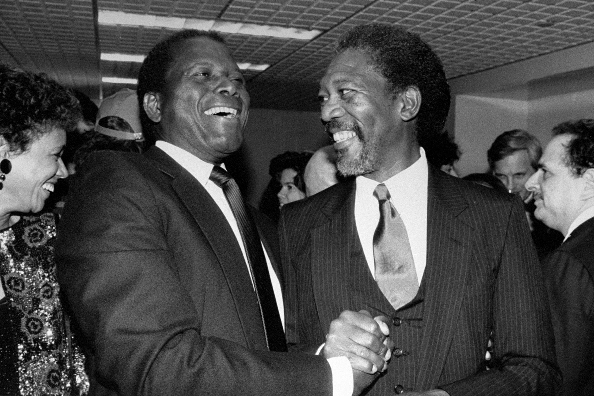 Actors Morgan Freeman (right) and Sidney Poitier at the D.W.