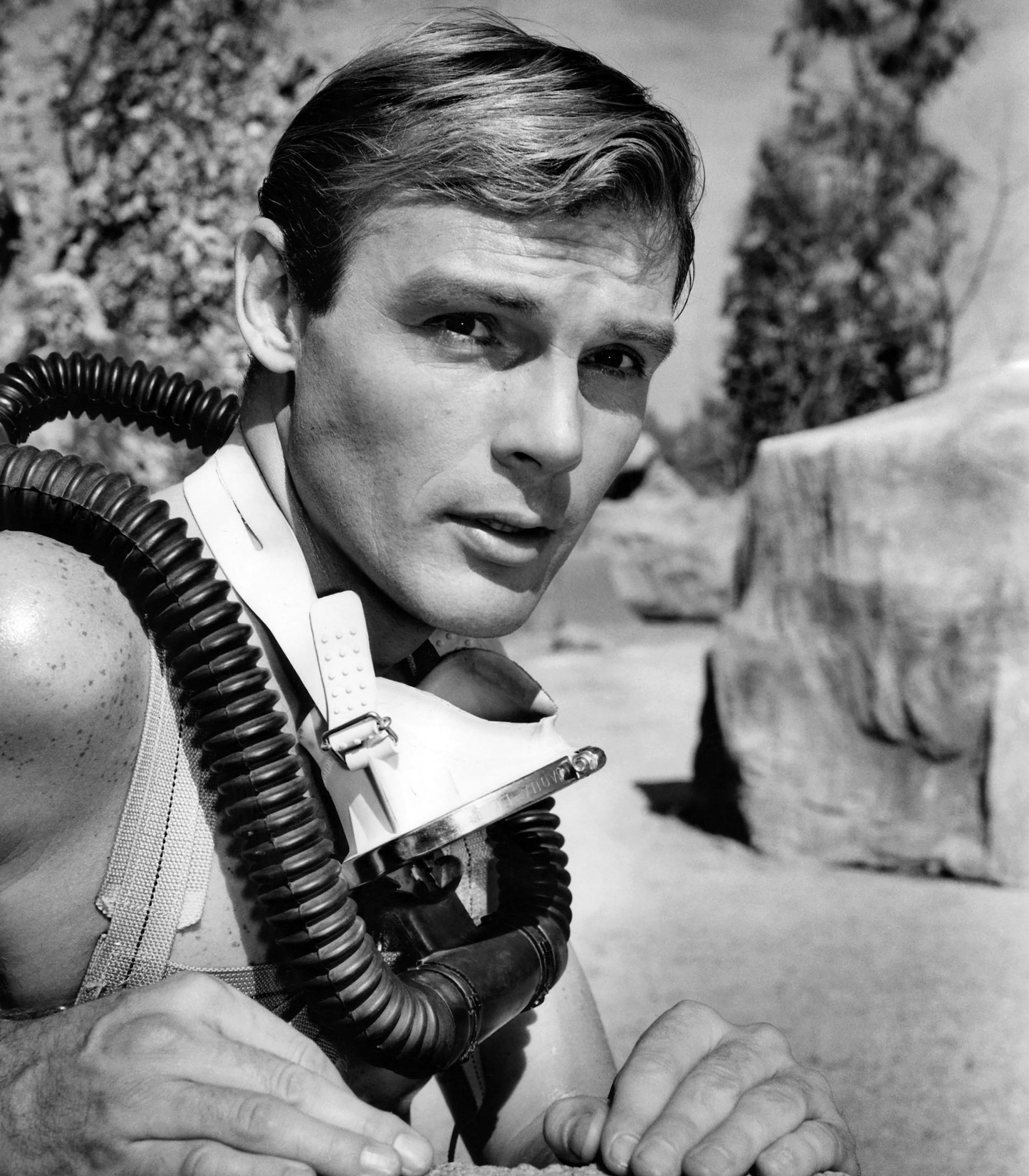 Adam West getting ready to explore an underwater cave, ca. 1961