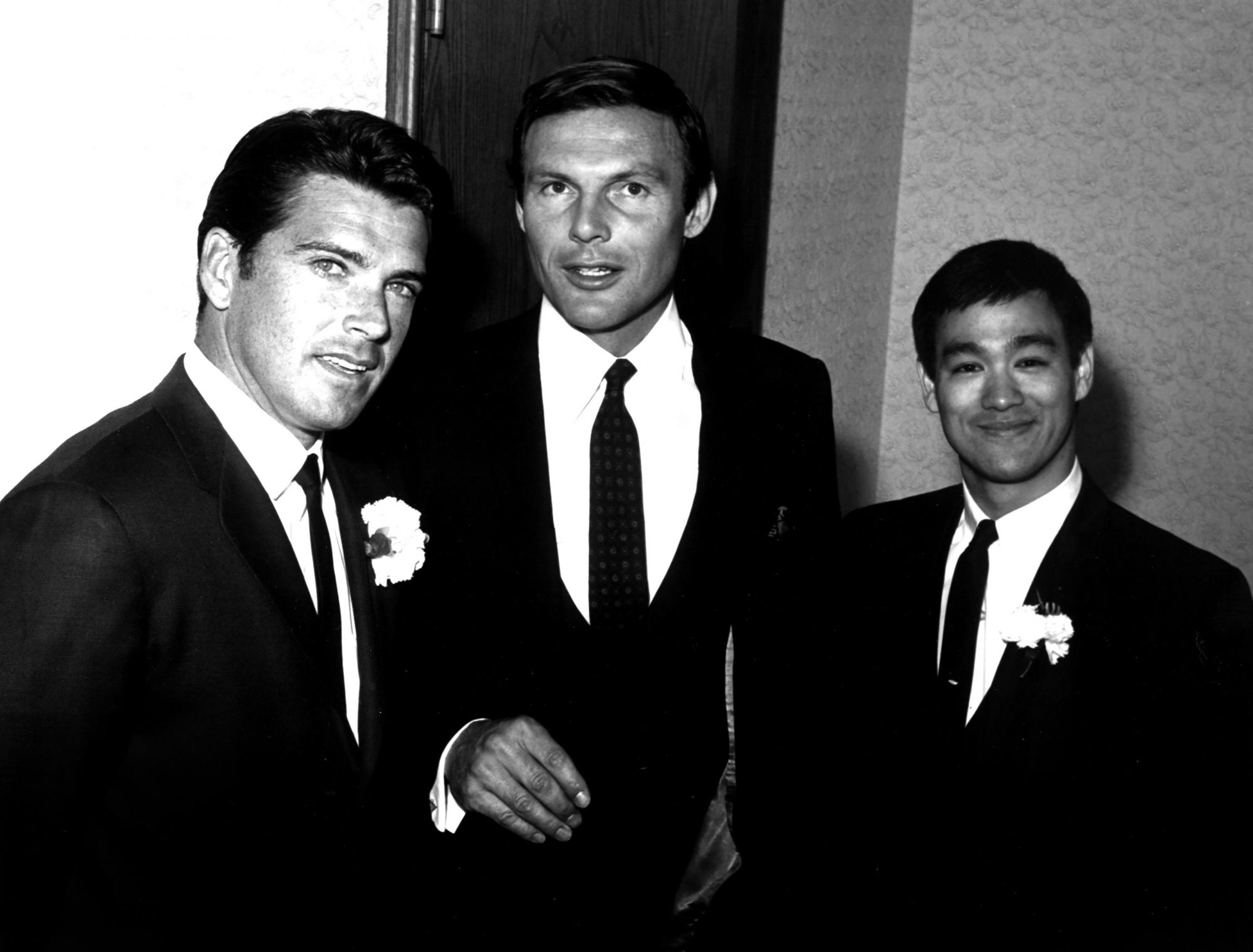 Van Williams, Adam West and Bruce Lee during a break from the BATMAN and GREEN HORNET series, c. 196