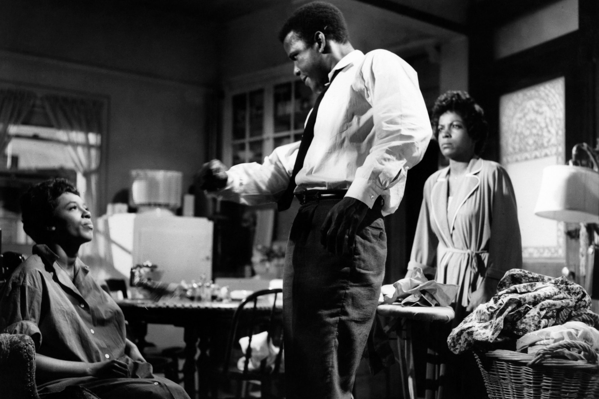 A RAISIN IN THE SUN, from left: Diana Sands, Sidney Poitier, Ruby Dee, 1961 araisininthesun-fsct03(a