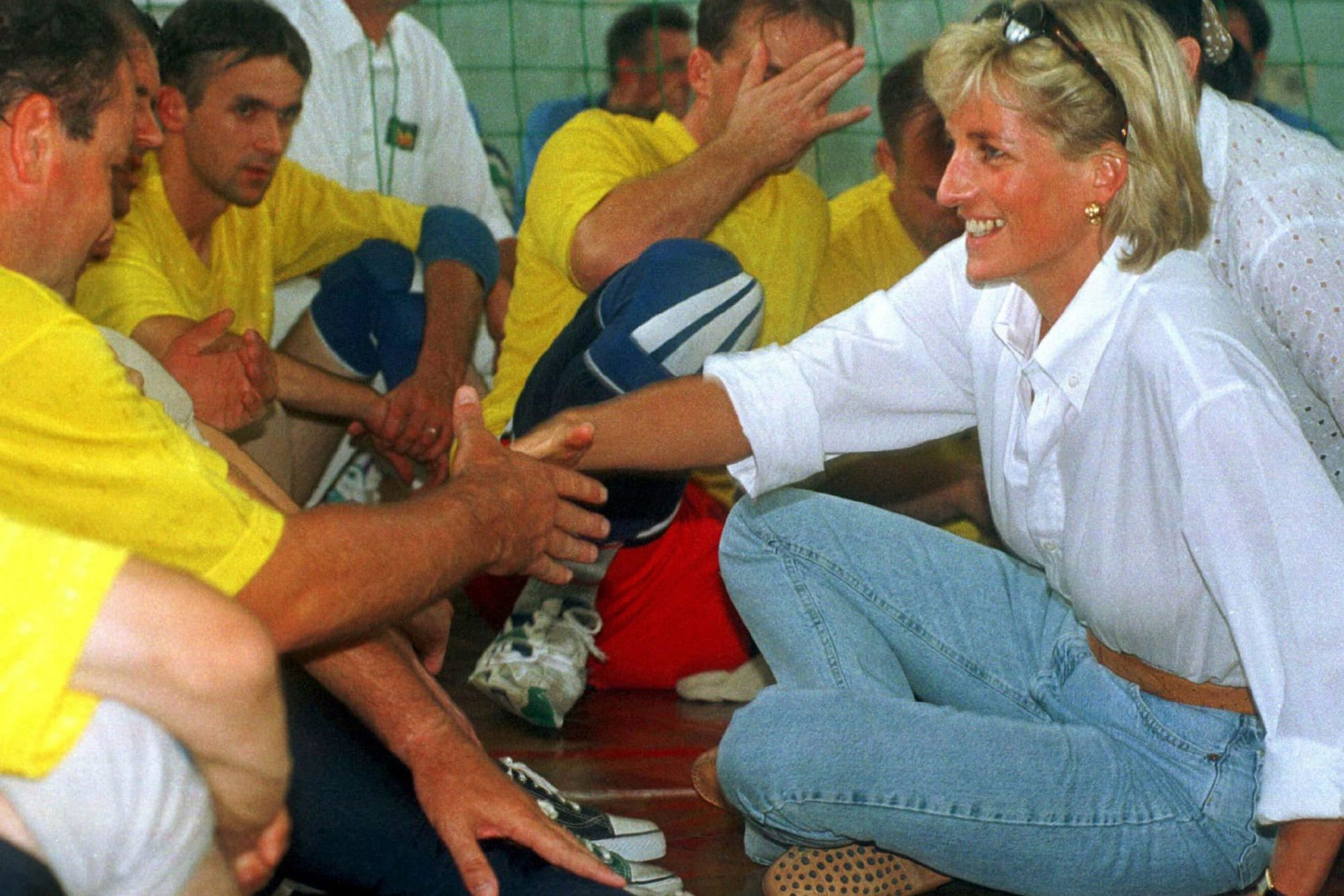 Diana enthusiastically met with locals to hear their stories of pain, loss, and survival