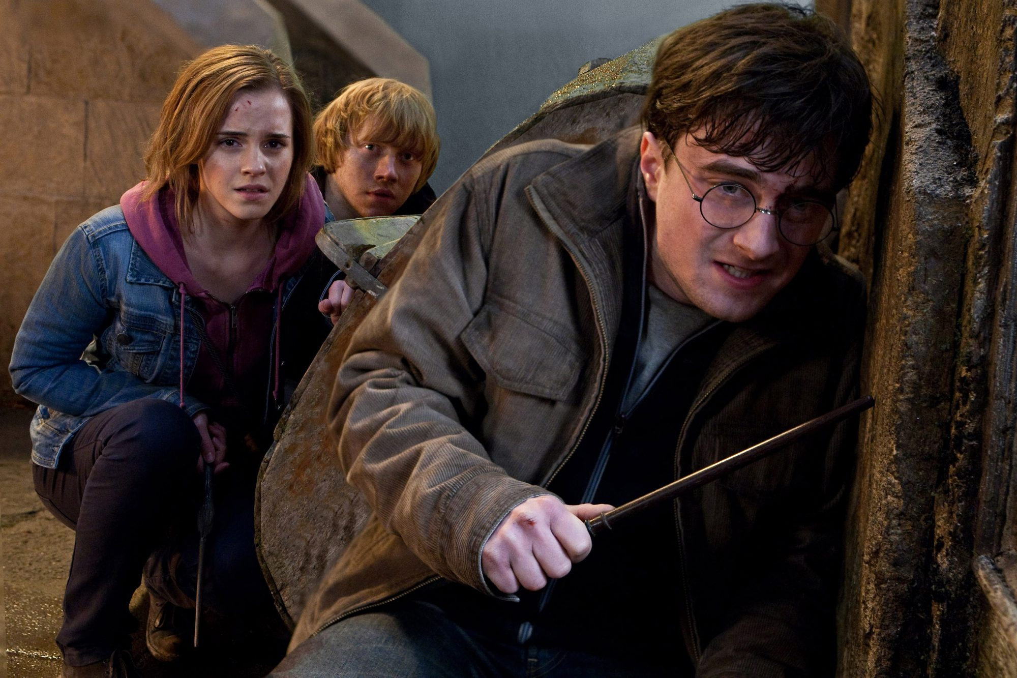 HARRY POTTER AND THE DEATHLY HALLOWS: PART 2, from left: Emma Watson, Rupert Grint, Daniel Radcliffe
