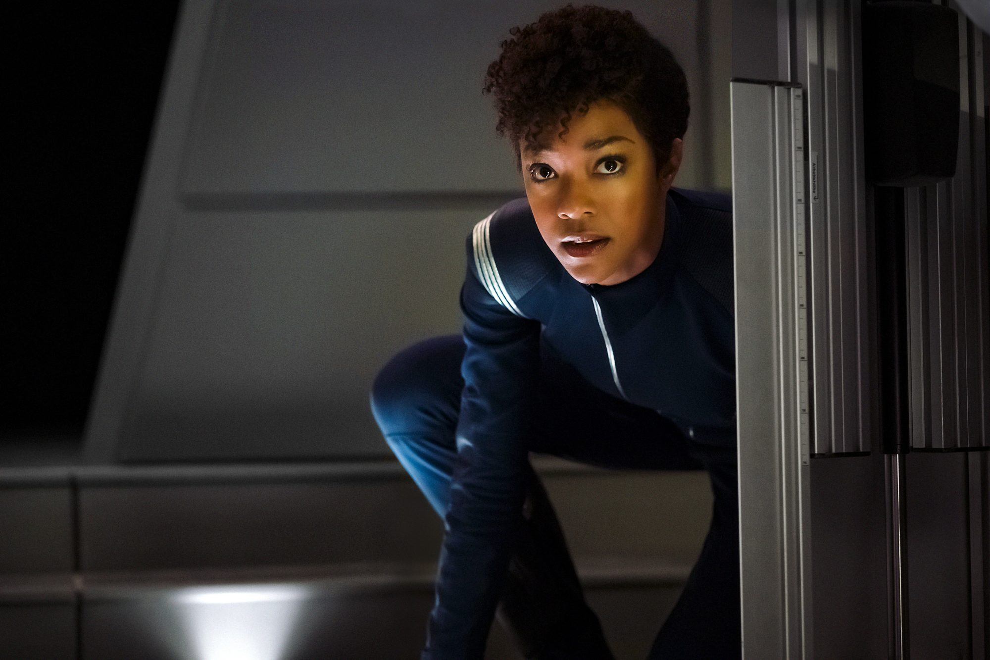 Michael Burnham avoids a threat.