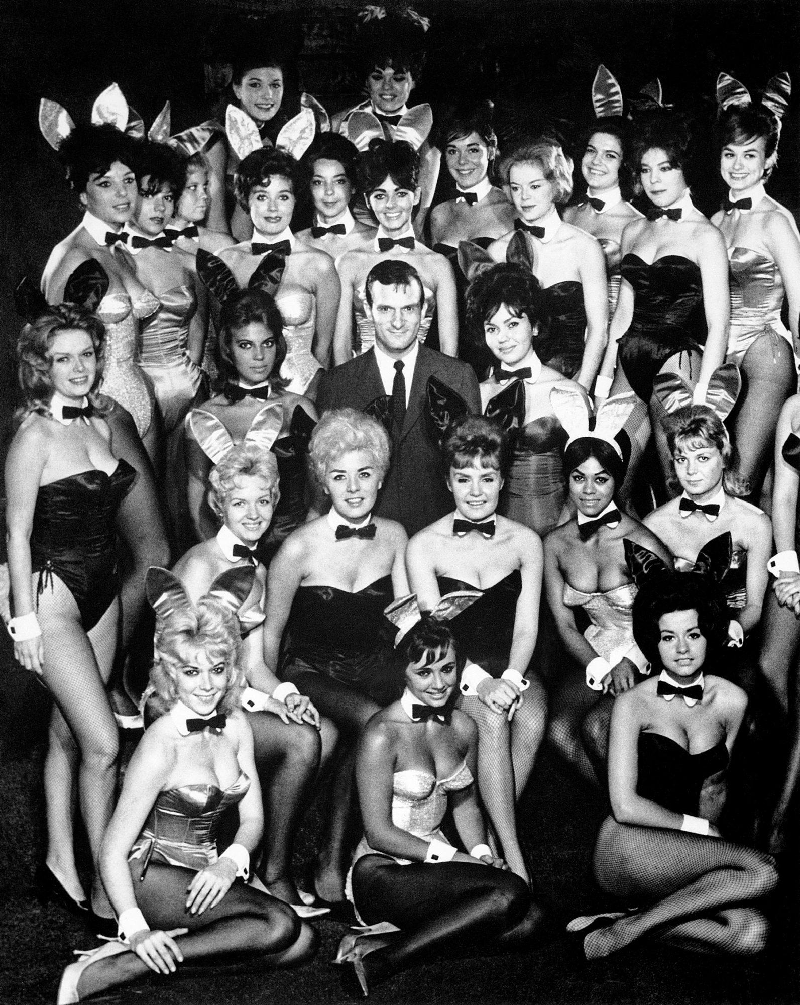 Hugh Hefner Surrounded by Playboy Bunnies