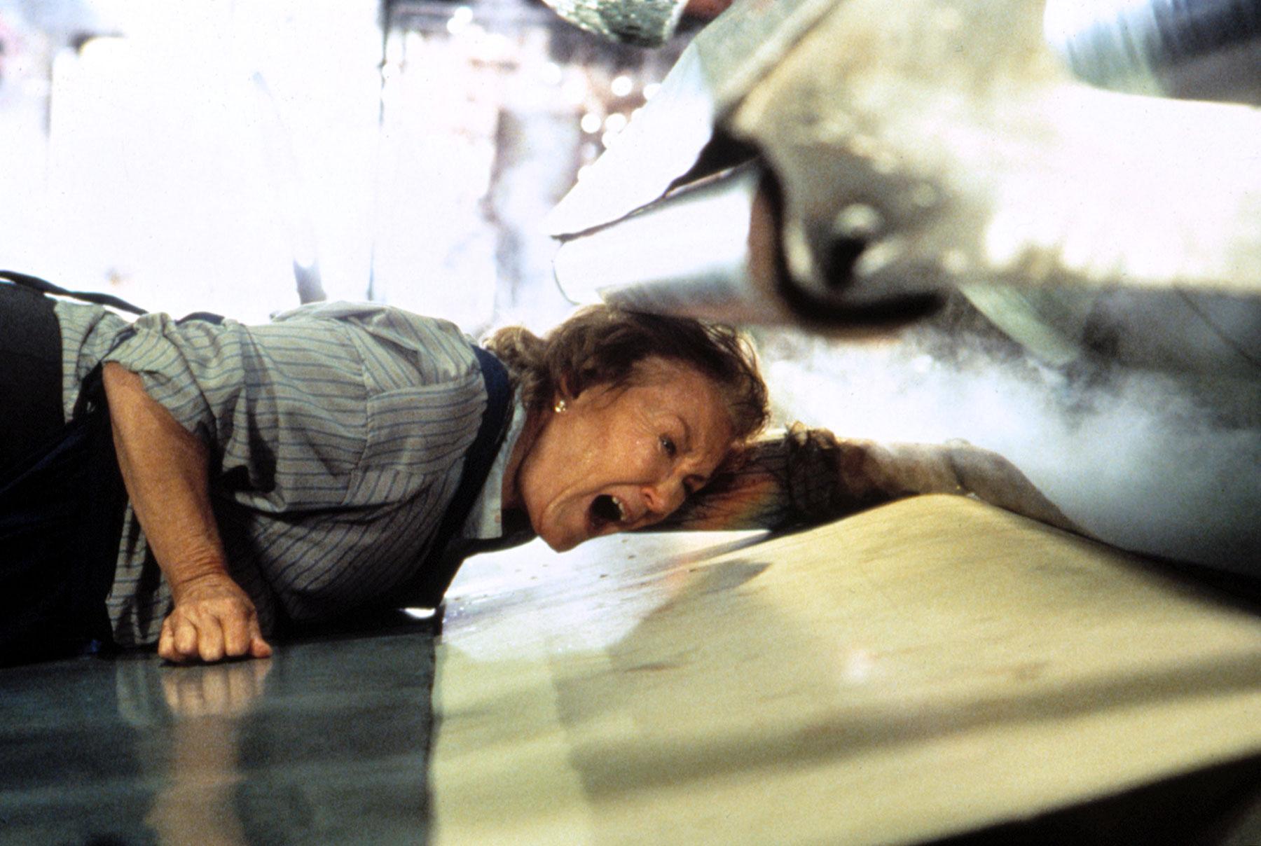 MANGLER, Vera Blacker being devoured by machine, 1995.