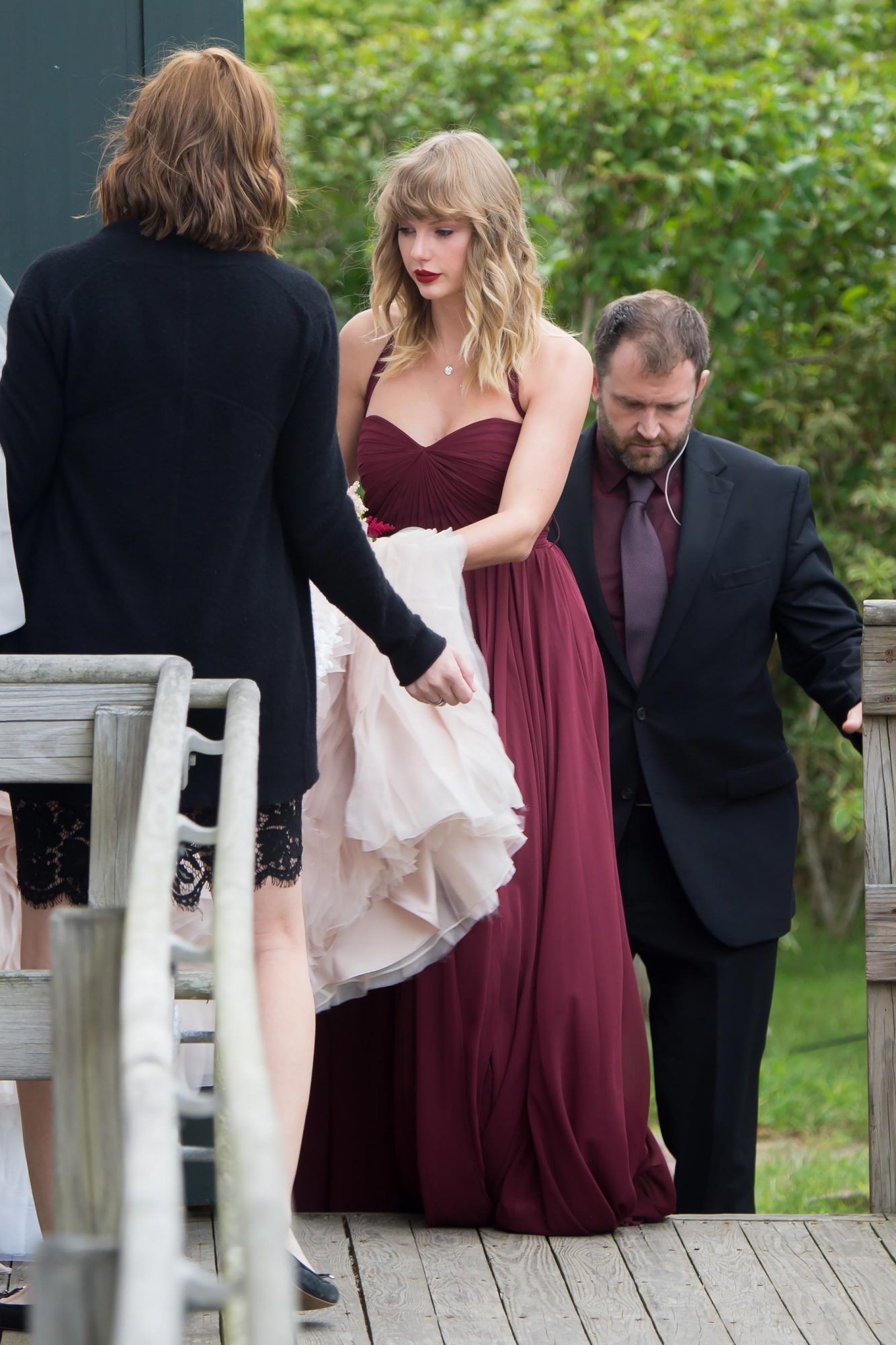Taylor Swift is seen carrying the back of her BFF Abigail's wedding dress as they arrive at a church in Martha's Vineyard
