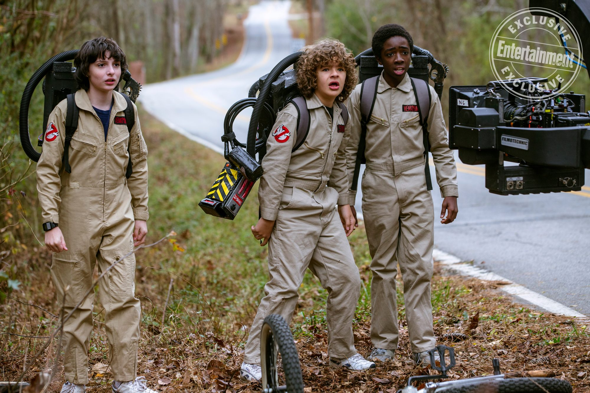 Finn Wolfhard as Mike Wheeler, Gaten Matarazzo as Dustin Henderson, and Caleb McLaughlin as Lucas Sinclair