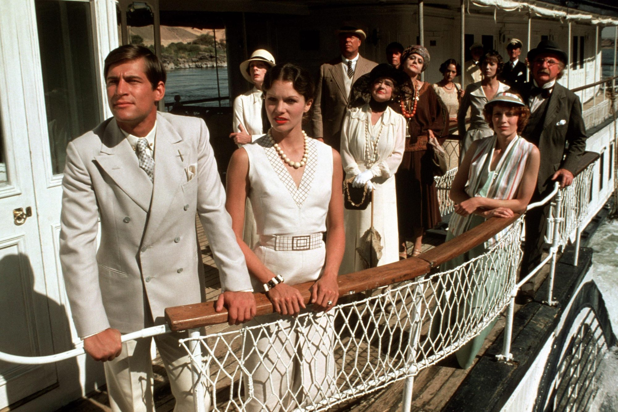 DEATH ON THE NILE, front: Simon MacCorkindale, Lois Chiles, first row: Maggie Smith, Bette Davis, Mi