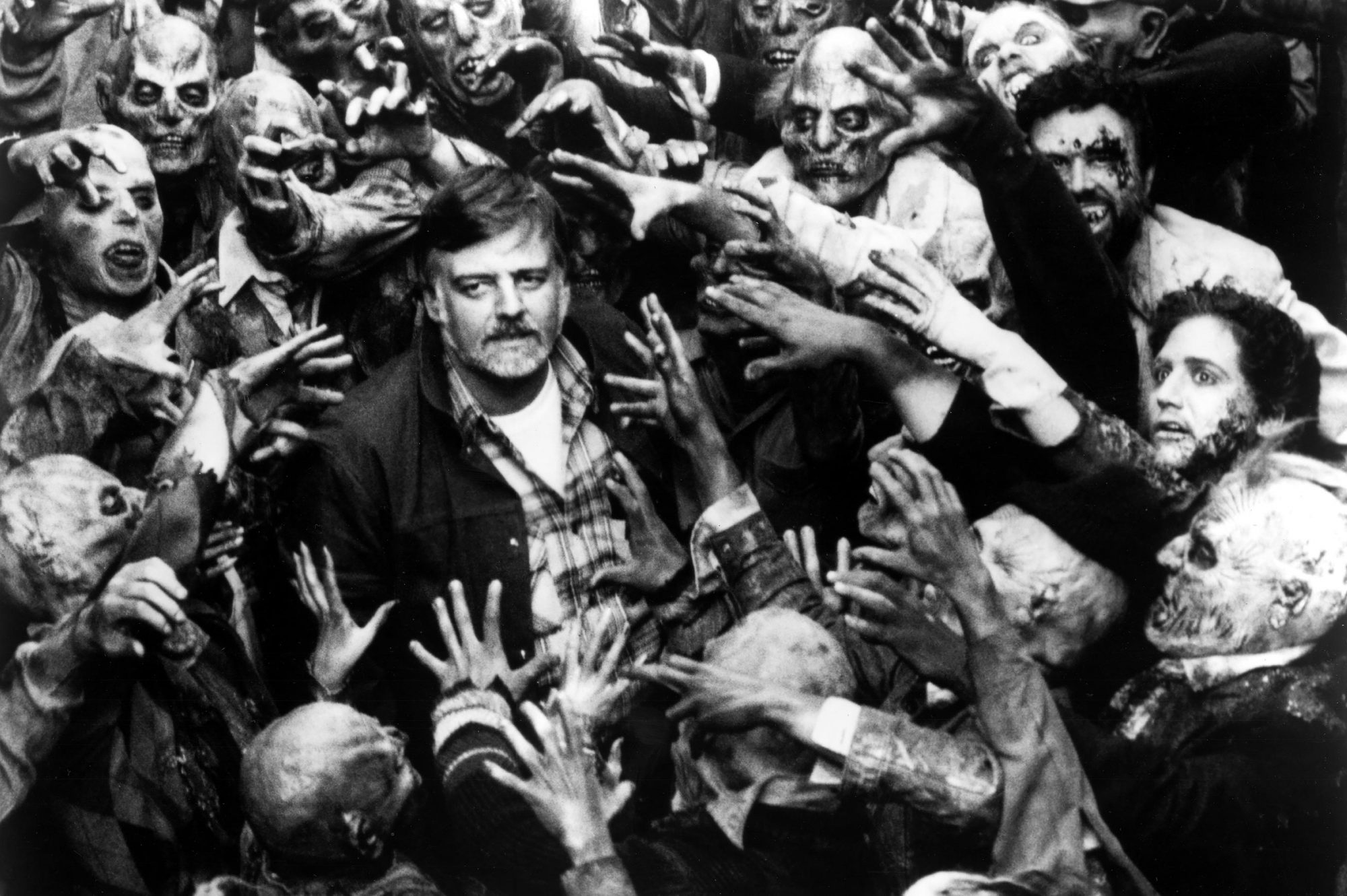 DAY OF THE DEAD, Director George A. Romero and zombies on set, 1985. (c) United Film/ Courtesy: Ever