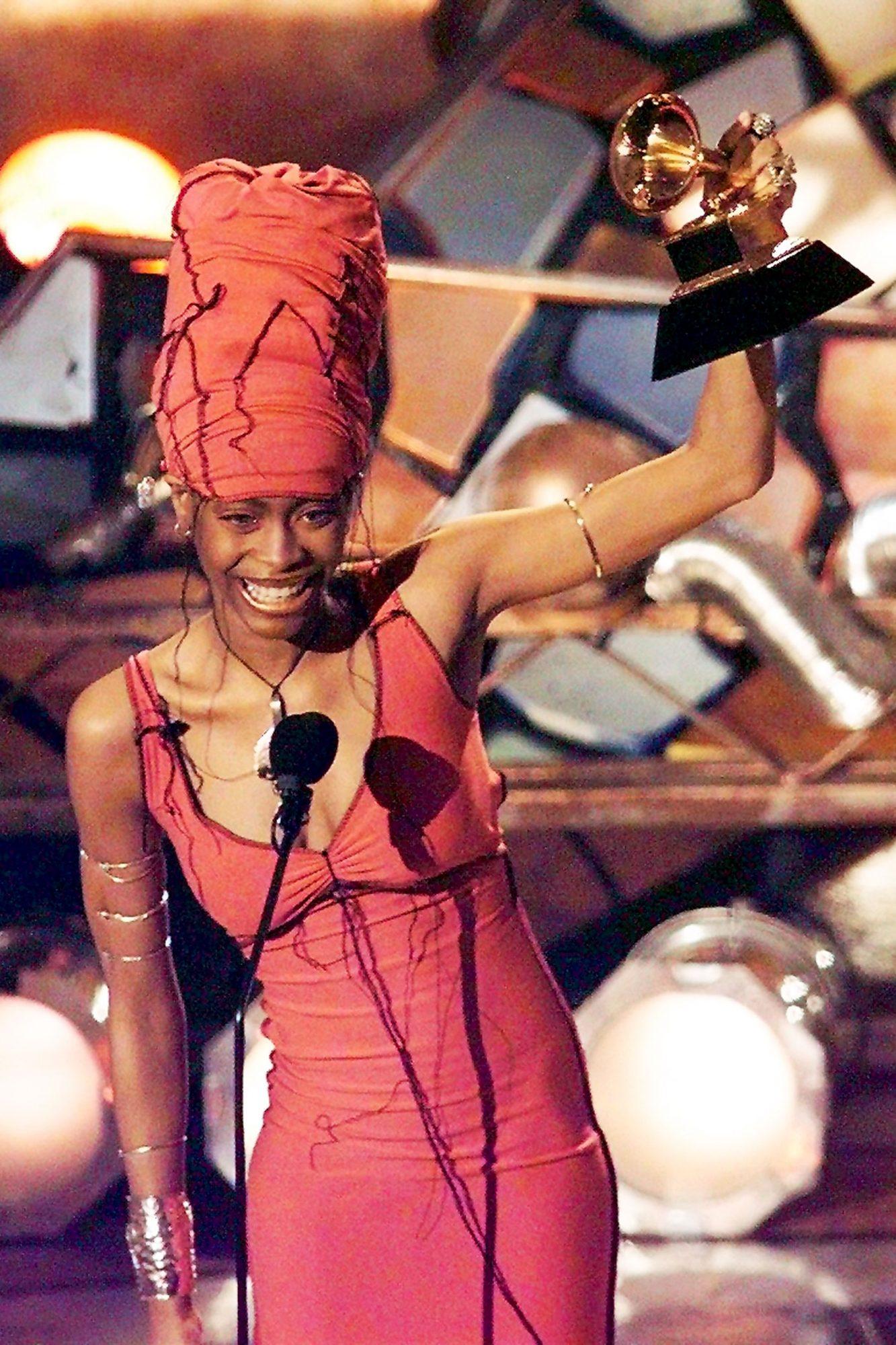 Erykah Badu holds up her Grammy after winning in t