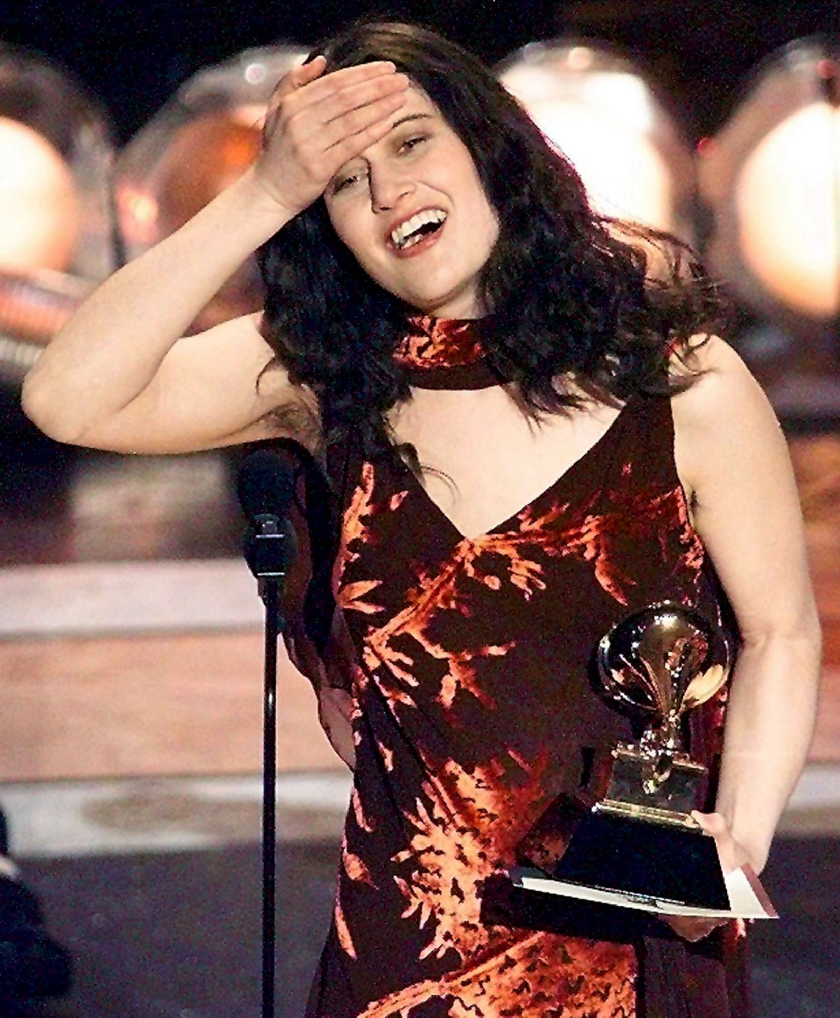 Paula Cole holds her head after winning the Best N