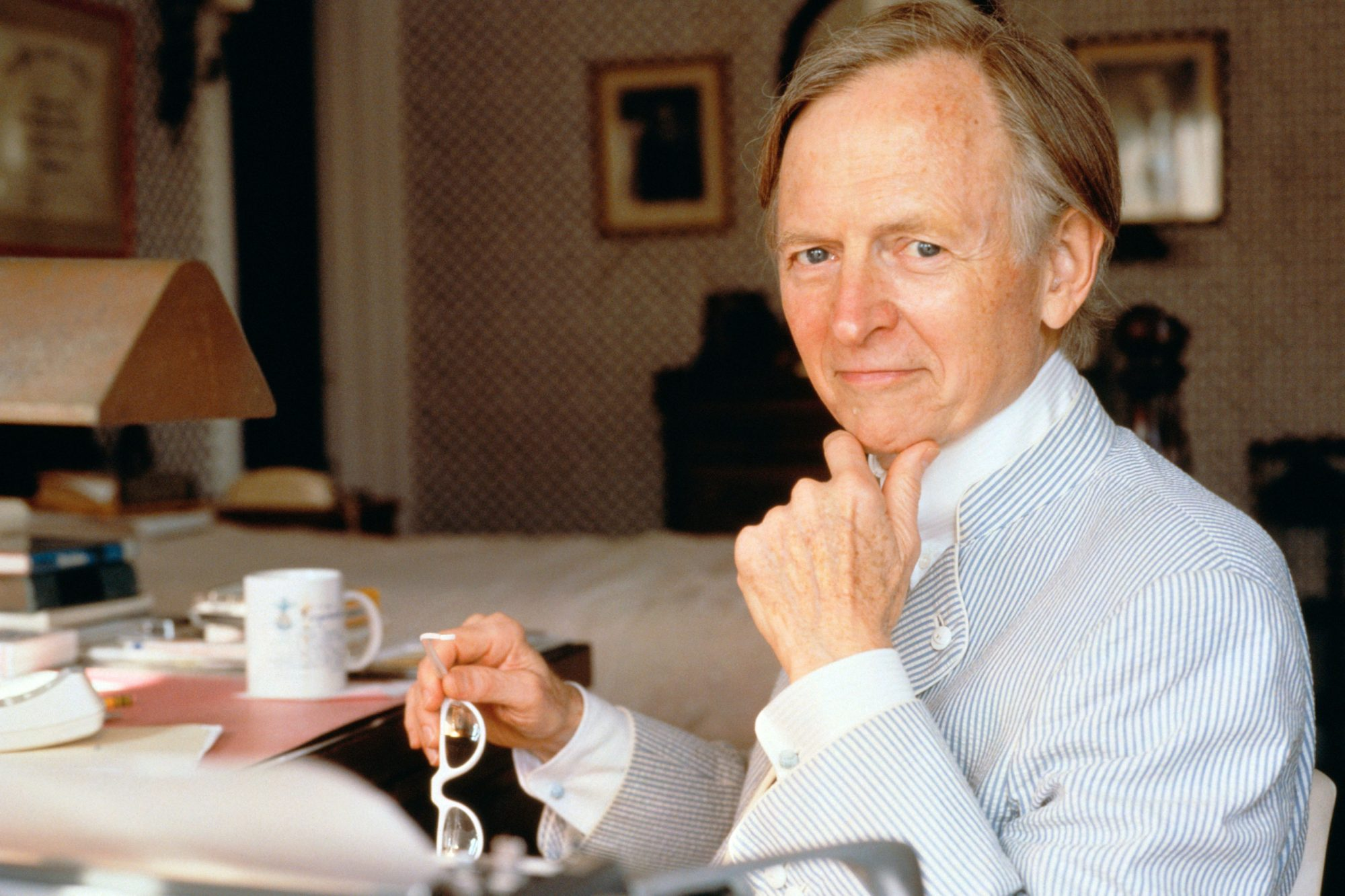 Novelist Tom Wolfe Seated at Desk