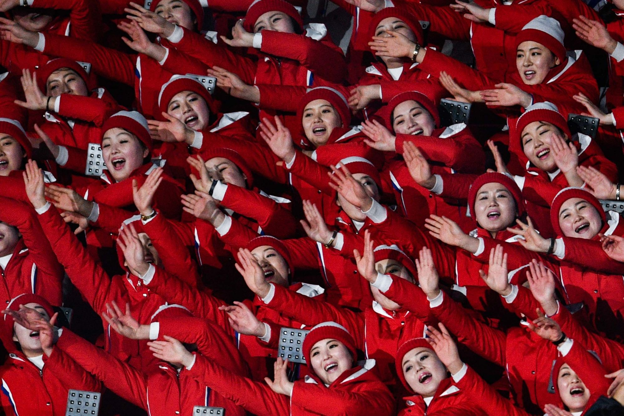 North Korean cheerleaders wave
