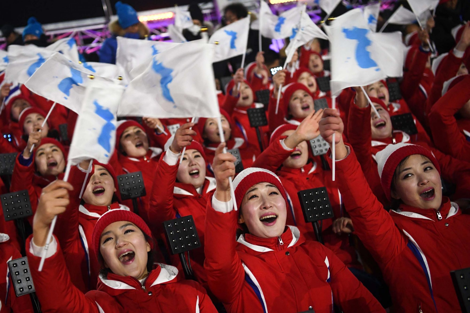 Members of the North Korean cheering band wave flags