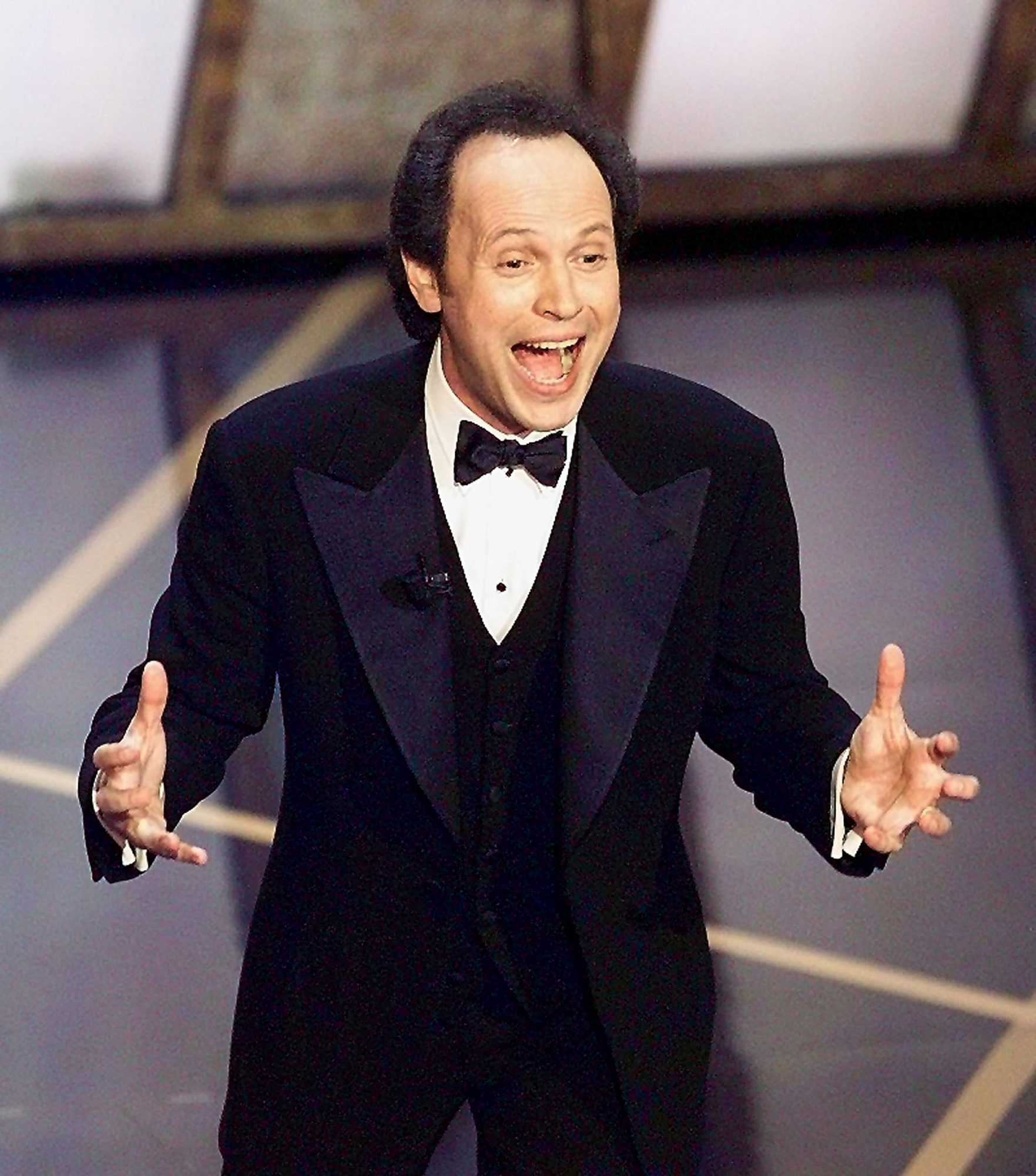 Comedian Billy Crystal performs the opening act as