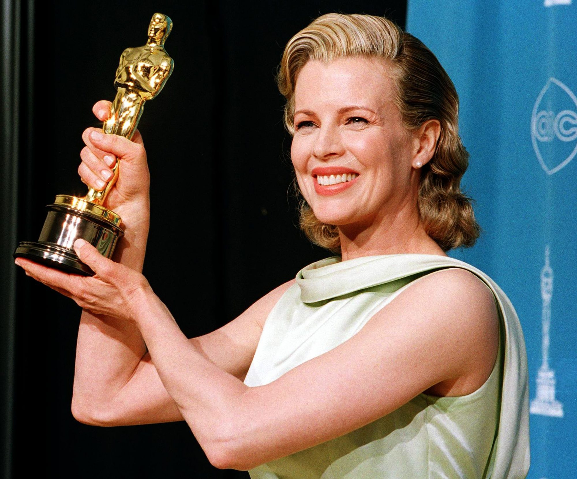 Actress Kim Basinger holds up her Oscar for Best S