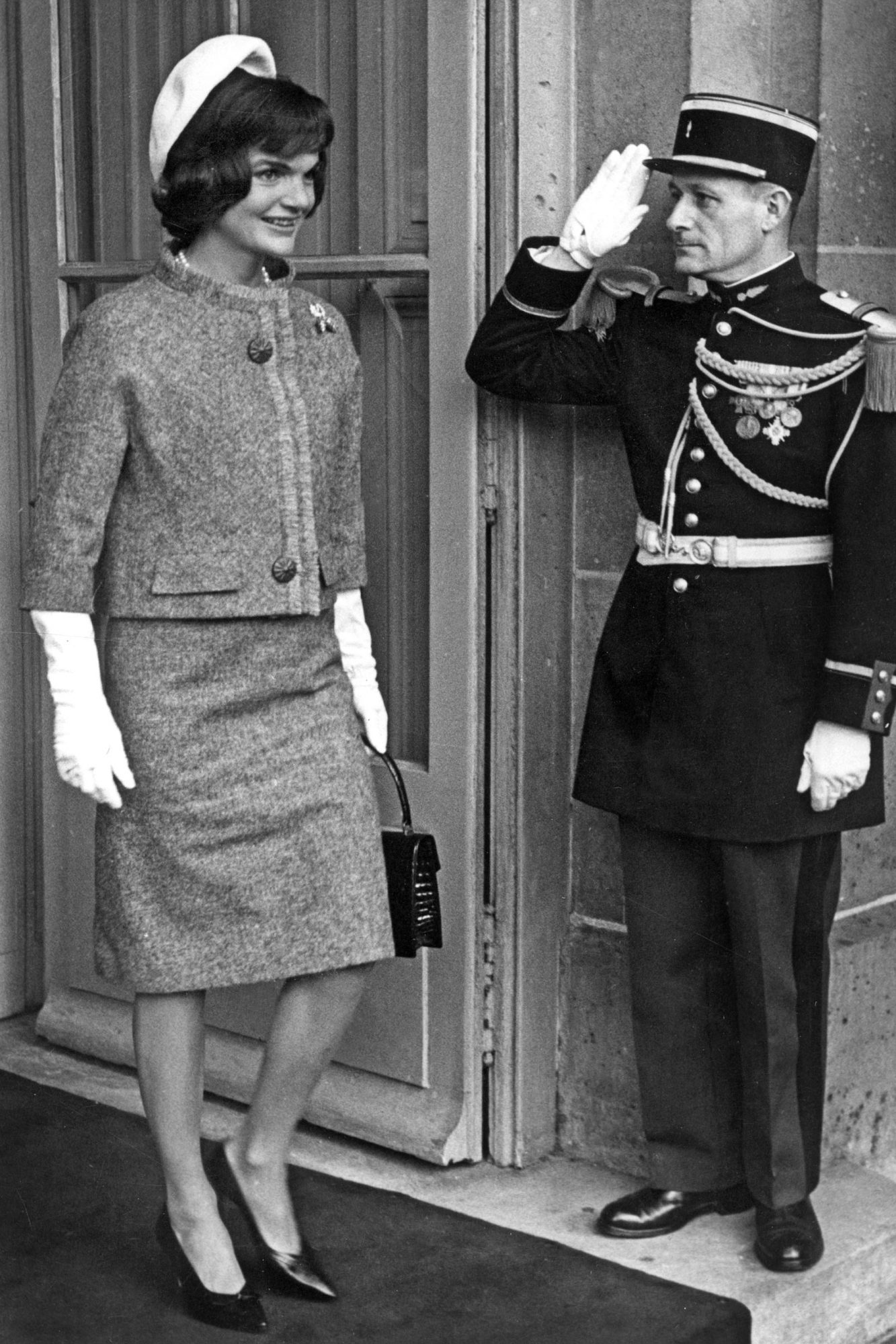 Jackie Kennedy in Paris on june 2, 1961 (wearing tweed suit by Hubert de Givenchy for Ninon, hat by