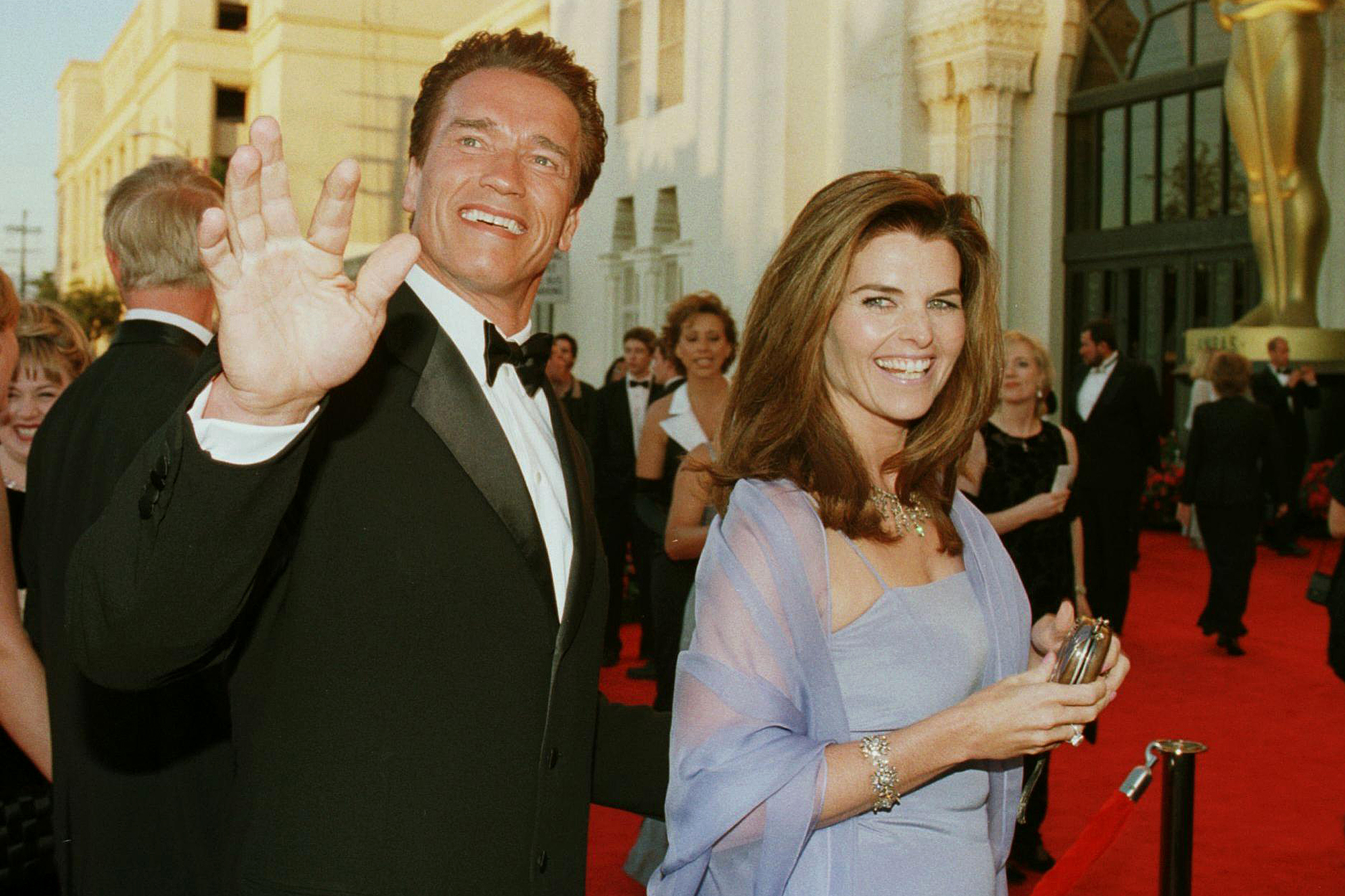 Actor Arnold Schwarzenegger (L) and his wife repor