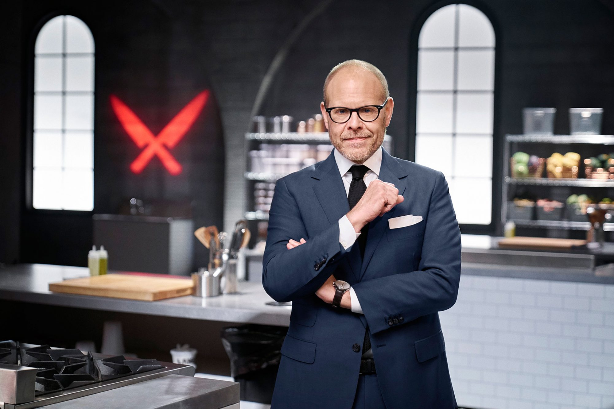 Host Alton Brown, as seen on Iron Chef Gauntlet, Season 2.