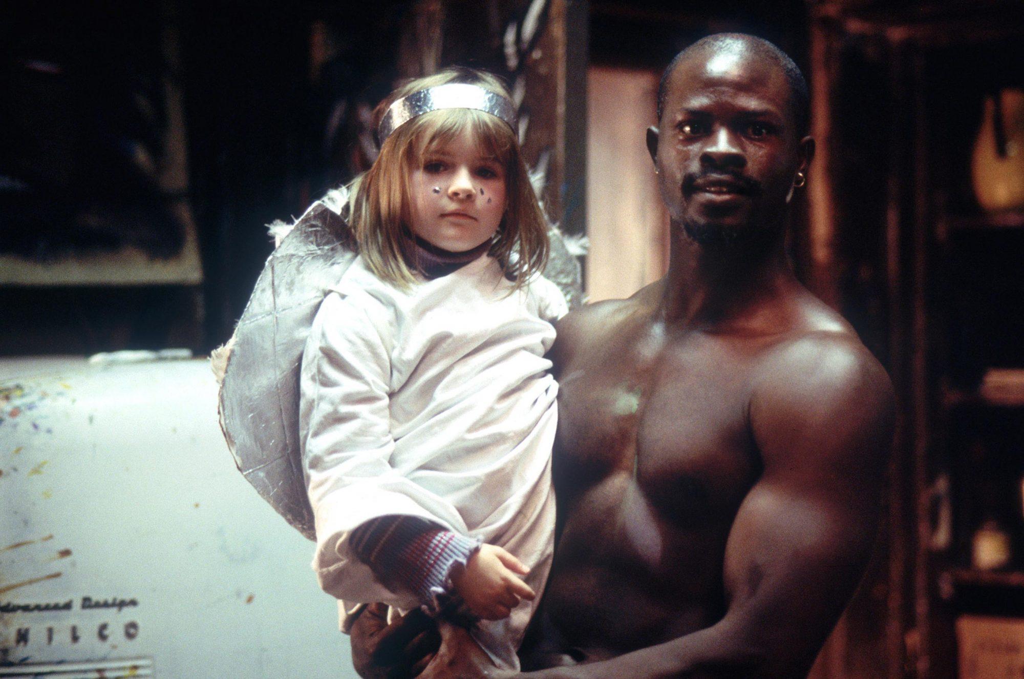 IN AMERICA, Emma Bolger, Djimon Hounsou, 2002, (c) Fox Searchlight/courtesy Everett Collection