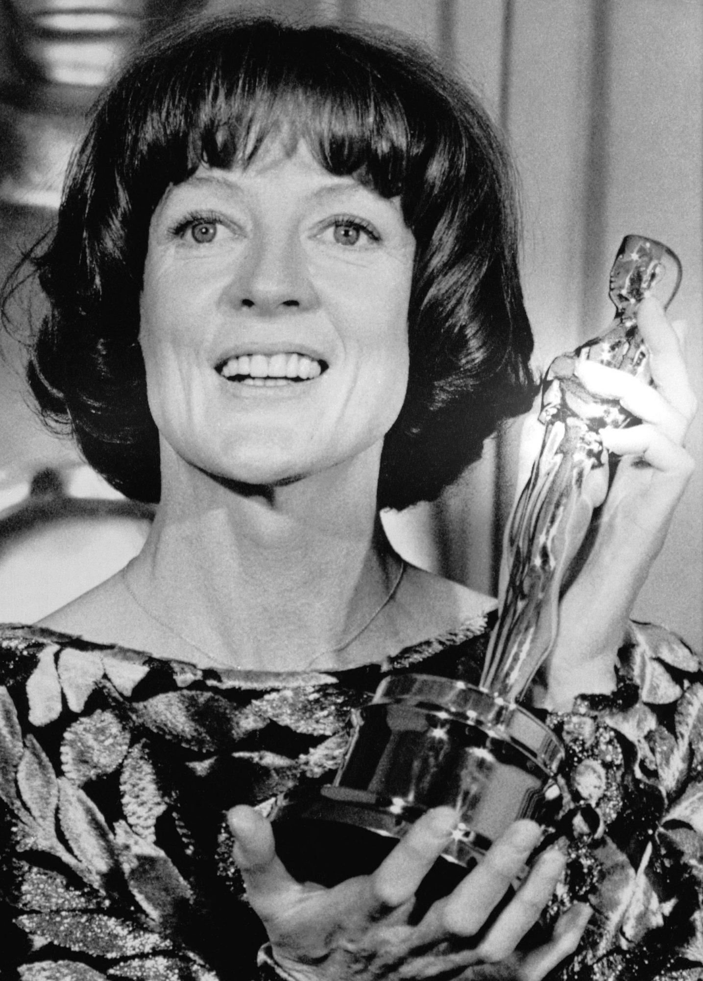 Maggie Smith Holds Oscar Award