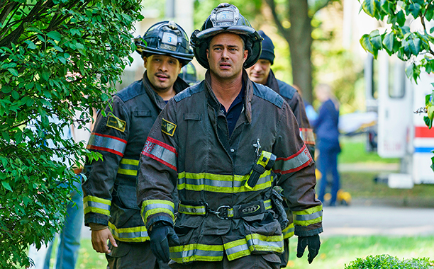 "ALL CROPS: CHICAGO FIRE -- ""One Hundred"" Episode 508 -- Pictured: (l-r) Joe Minoso as Joe Cruz, Taylor Kinney as Kelly Severide -- (Photo by: Parrish Lewis/NBC"