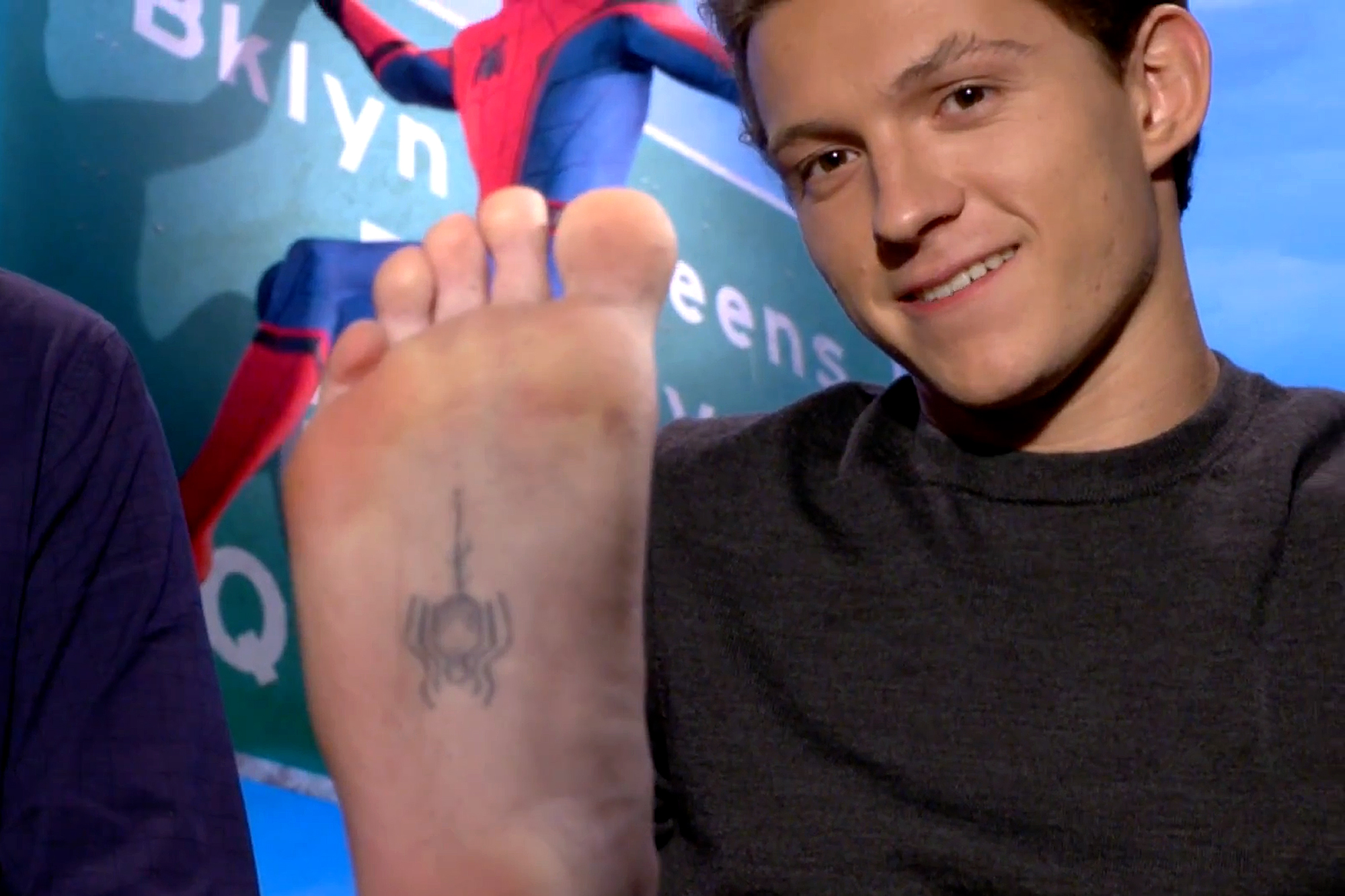 Tom Holland proudly shows off his Spider-Man tattoo.BacktotheMovies/YouTube