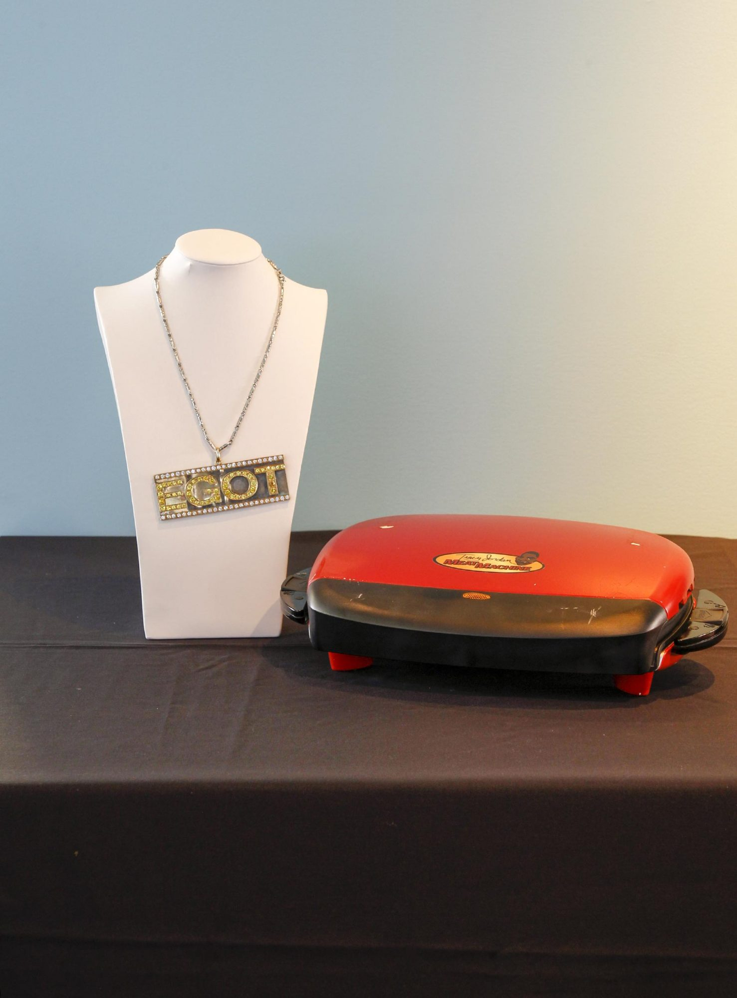 Tracy Jordan's (Tracy Morgan) EGOT necklace and The Tracy Jordan Meat Machine from 30 Rock