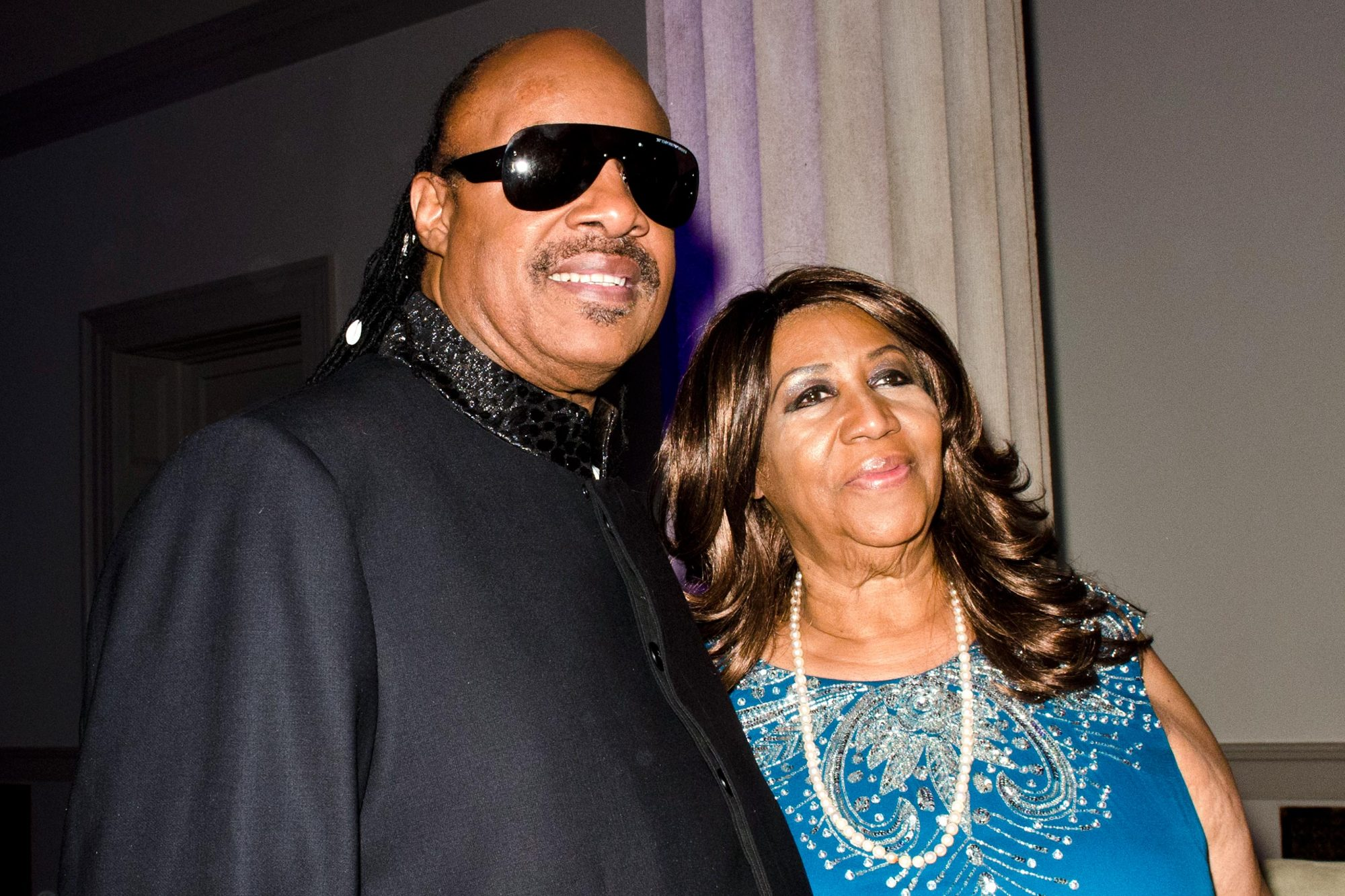 With Stevie Wonder during a BET Honors dinner at the Corcoran Gallery of Art in Washington, D.C., in 2012