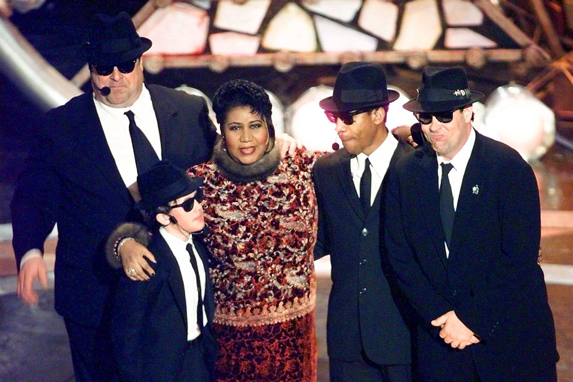 Aretha Franklin poses with the Blues Brothers John