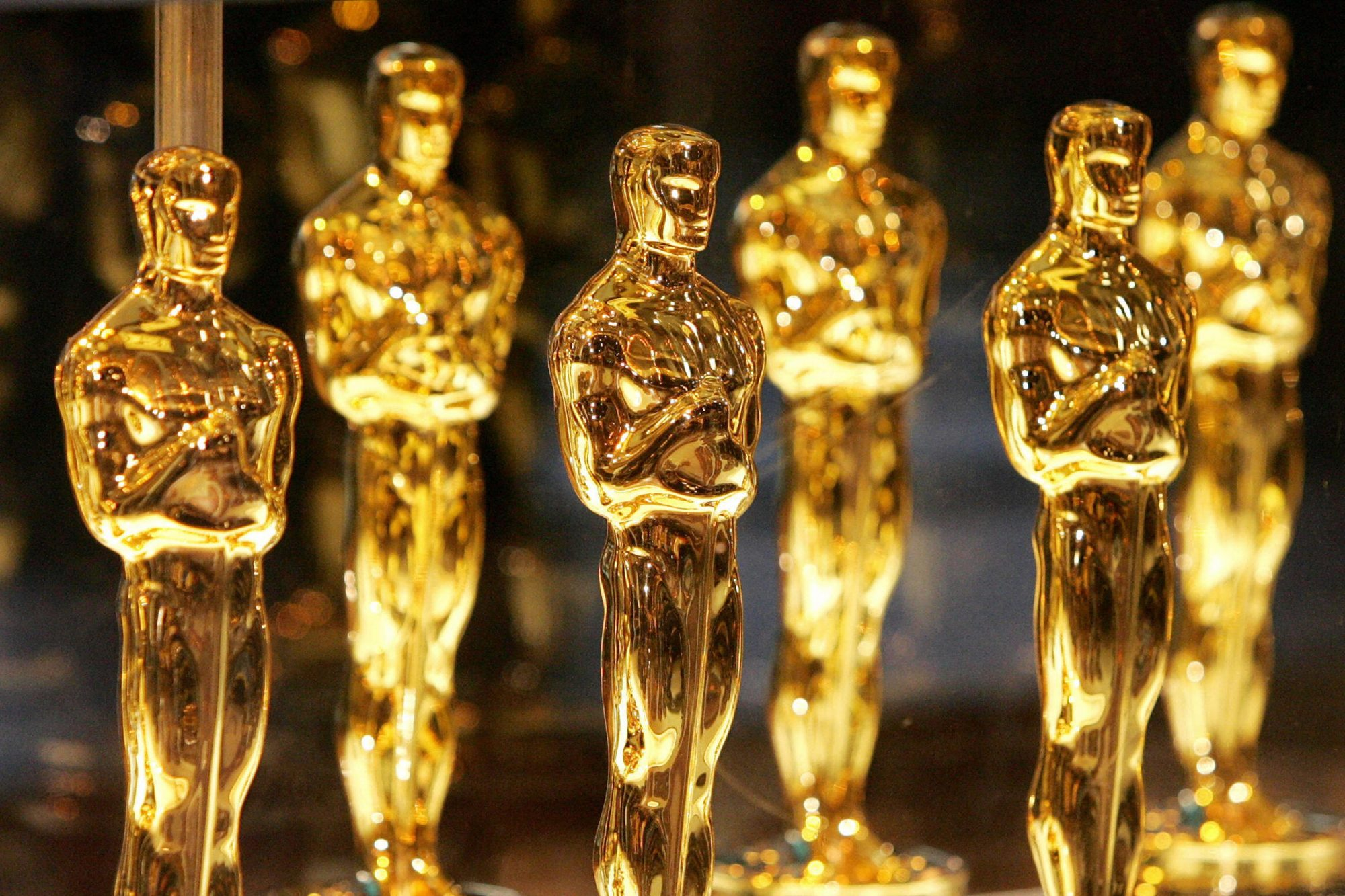Oscar statuettes are displayed at Times