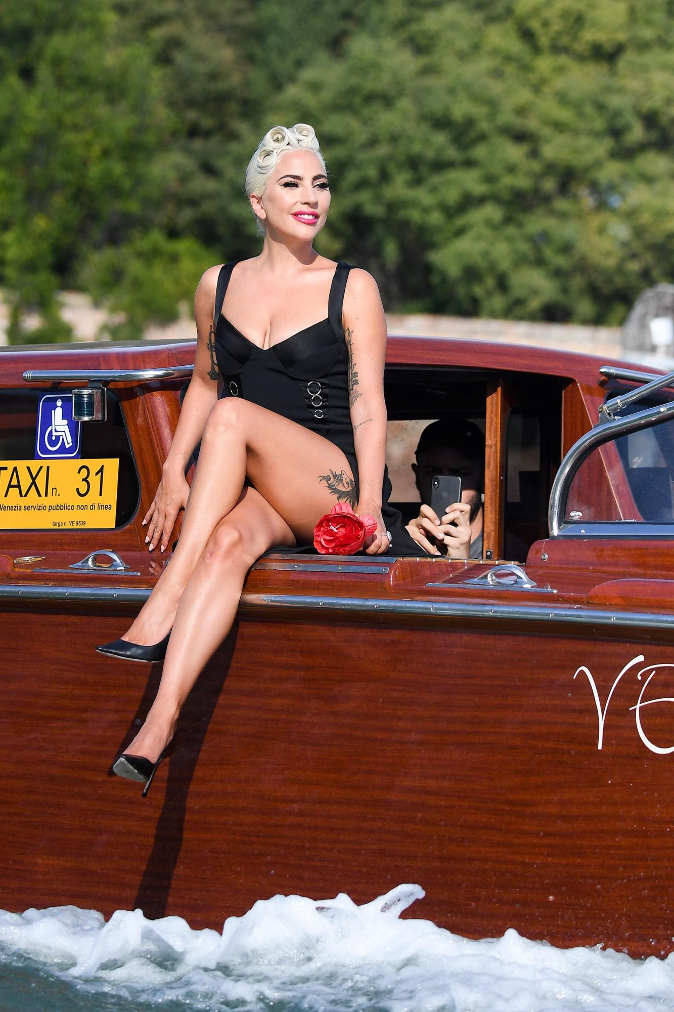 Lady Gaga spotted on a taxi boat in Venice
