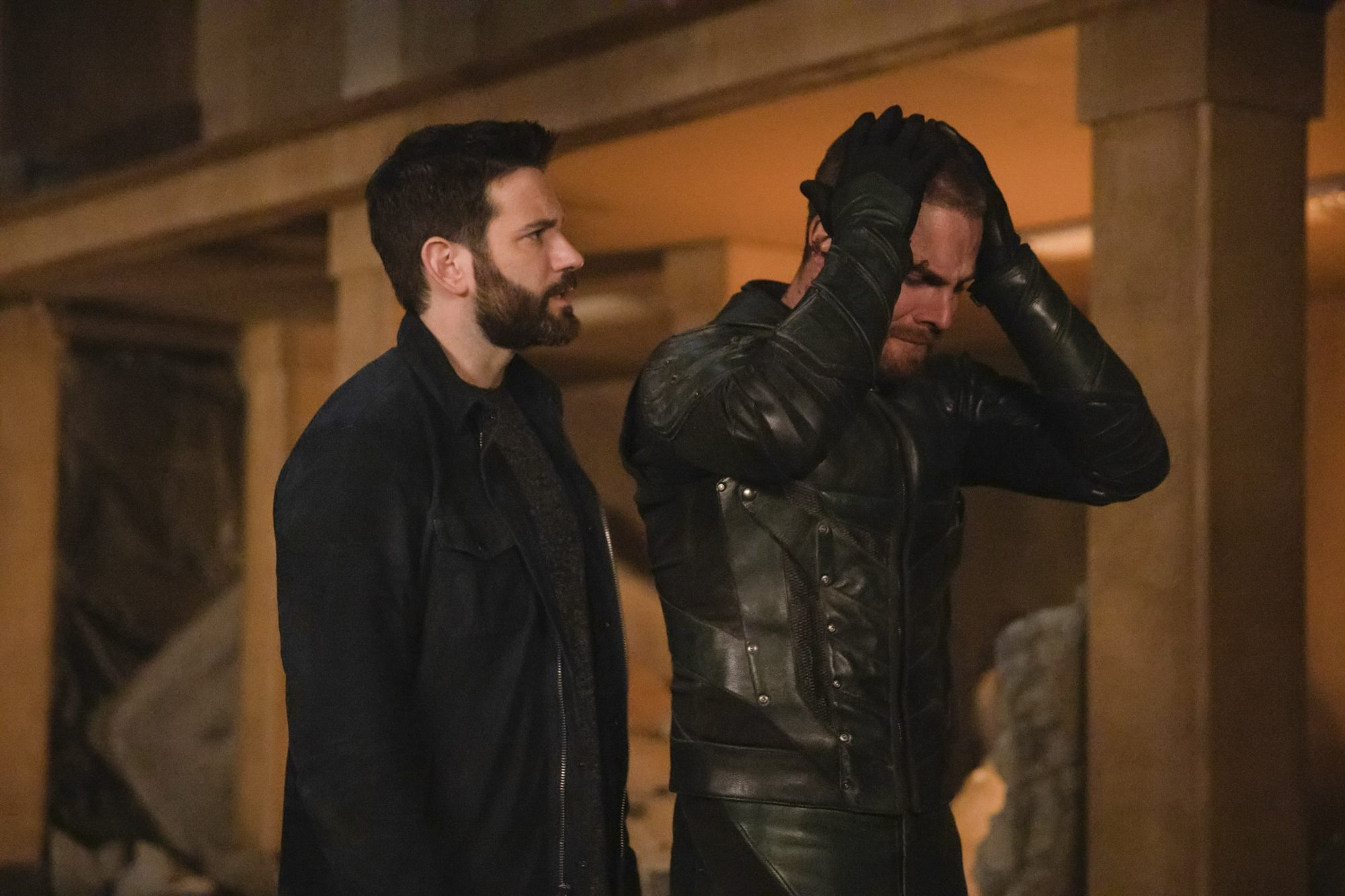 """Arrow -- """"Living Proof"""" -- Image Number: AR721b_0517r.jpg -- Pictured (L-R): Colin Donnell as Tommy Merlyn and Stephen Amell as Oliver Queen/Green Arrow -- Photo: Jack Rowand/The CW -- © 2019 The CW Network, LLC. All Rights Reserved."""