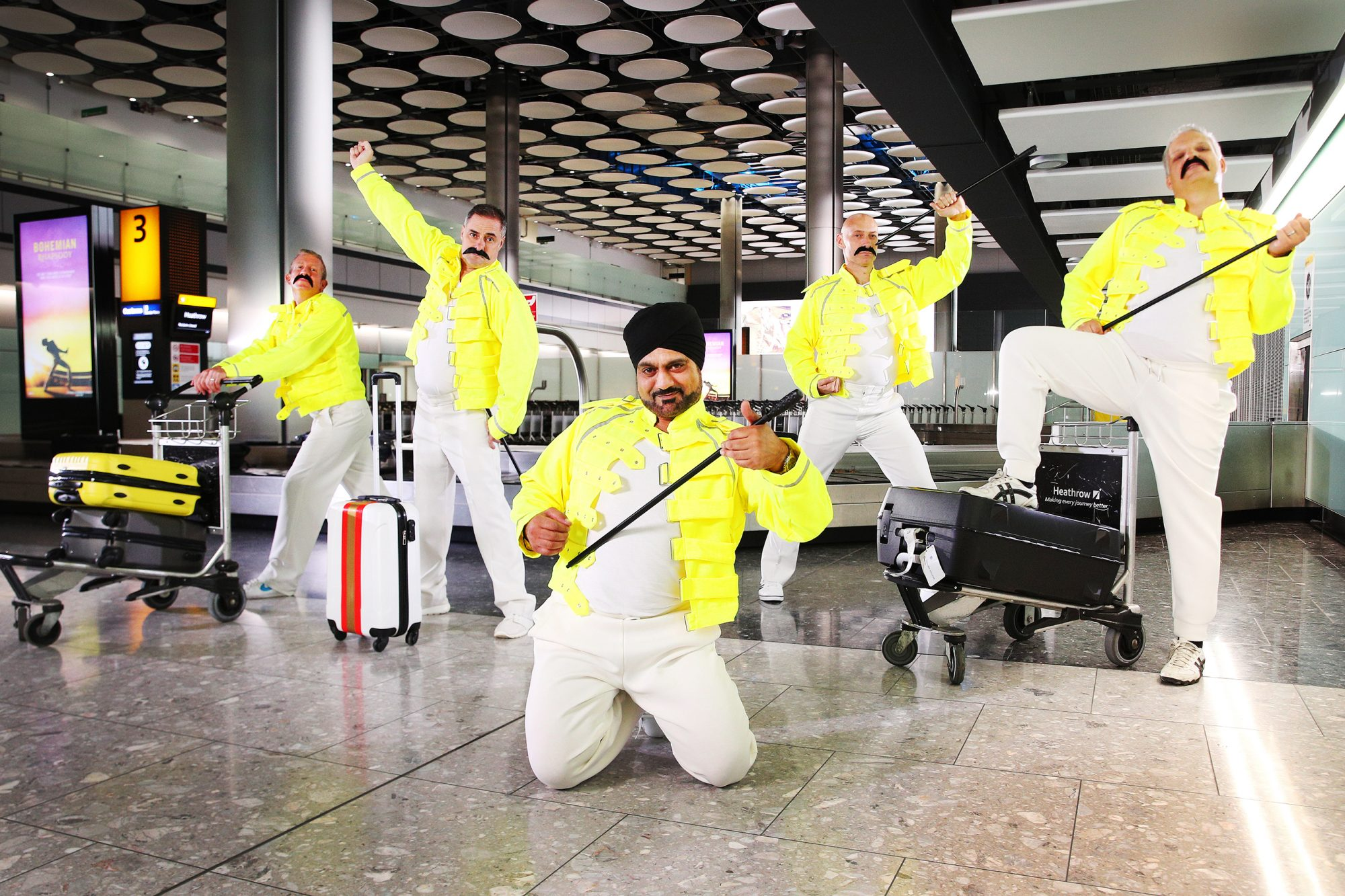 Baggage handlers perform tributes to Freddie Mercury, Heathrow, UK, 4th September 2018