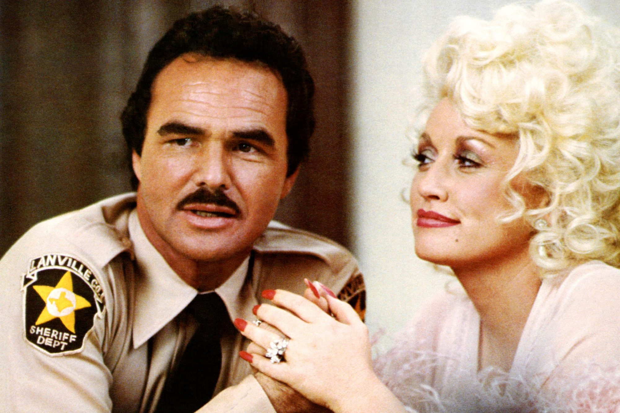 THE BEST LITTLE WHOREHOUSE IN TEXAS, from left: Burt Reynolds, Dolly Parton, 1982. ©Universal Pictur