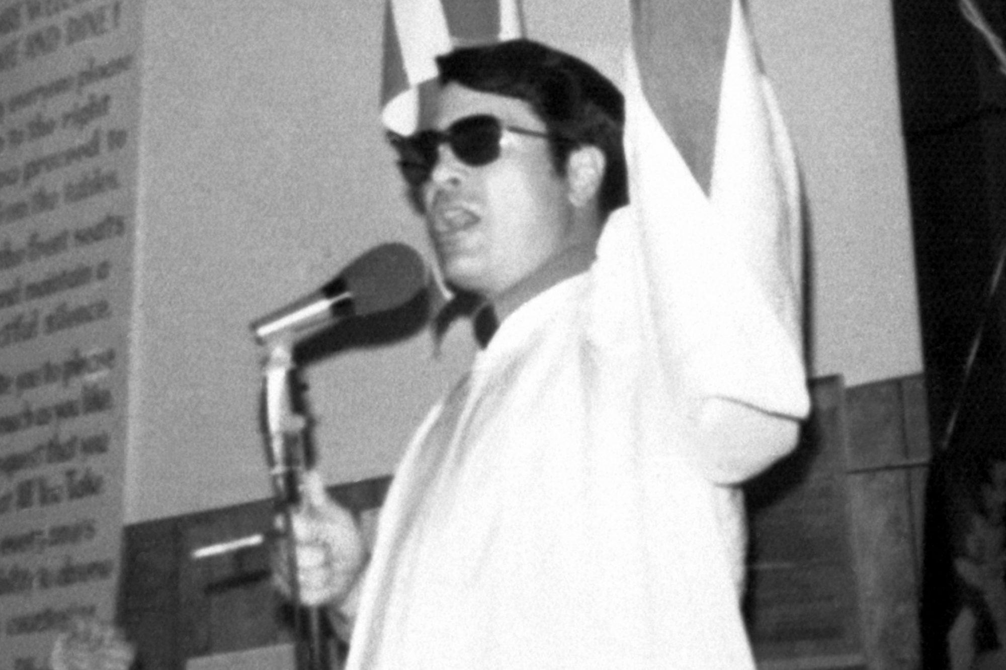 Reverend Jim Jones Raising His Fist