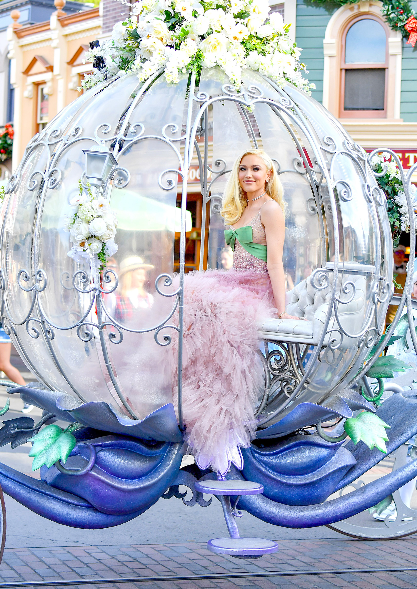 EXCLUSIVE: Gwen Stefani arrives to her performance at Disneyland in a princess horse drawn carriage wearing a princess dress