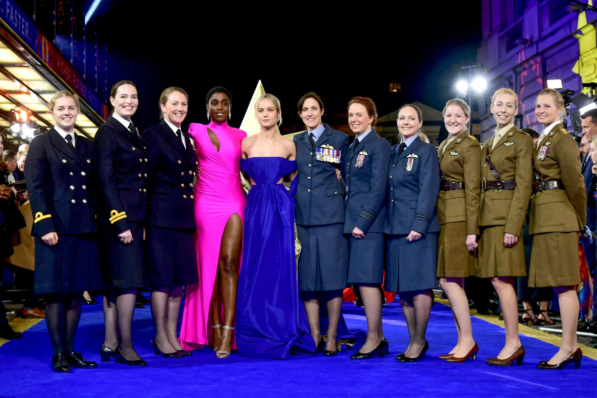 Brie Larson and Lashana Lynch pose with women from the British Armed Forces