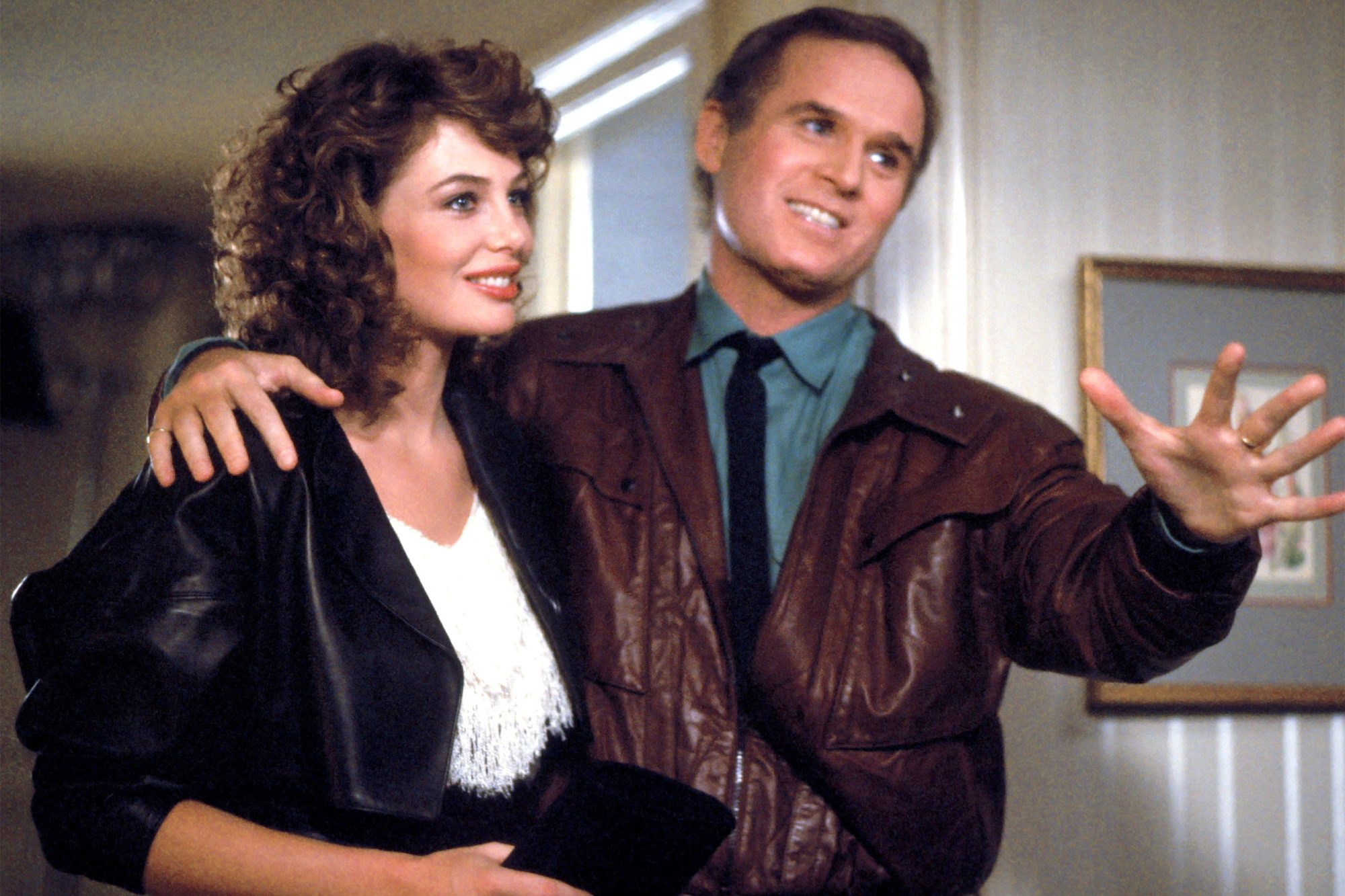 THE WOMAN IN RED, Kelly LeBrock, Charles Grodin, 1984, (c) Orion/courtesy Everett Collection