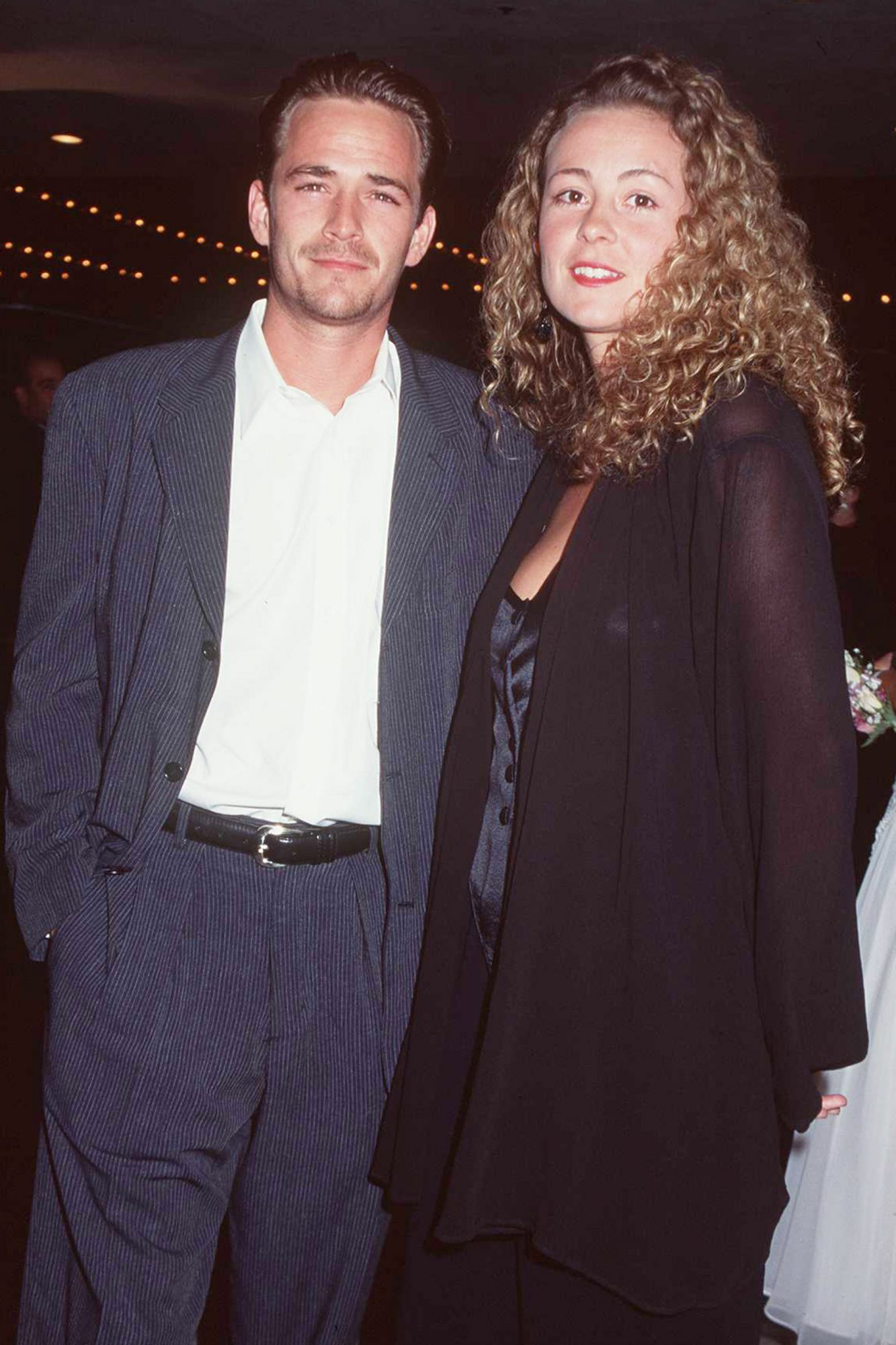"4/12/95 Westwood, CA. Luke Perry with his wife, Minnie Sharp at the premiere of ""Beauty And The Beas"