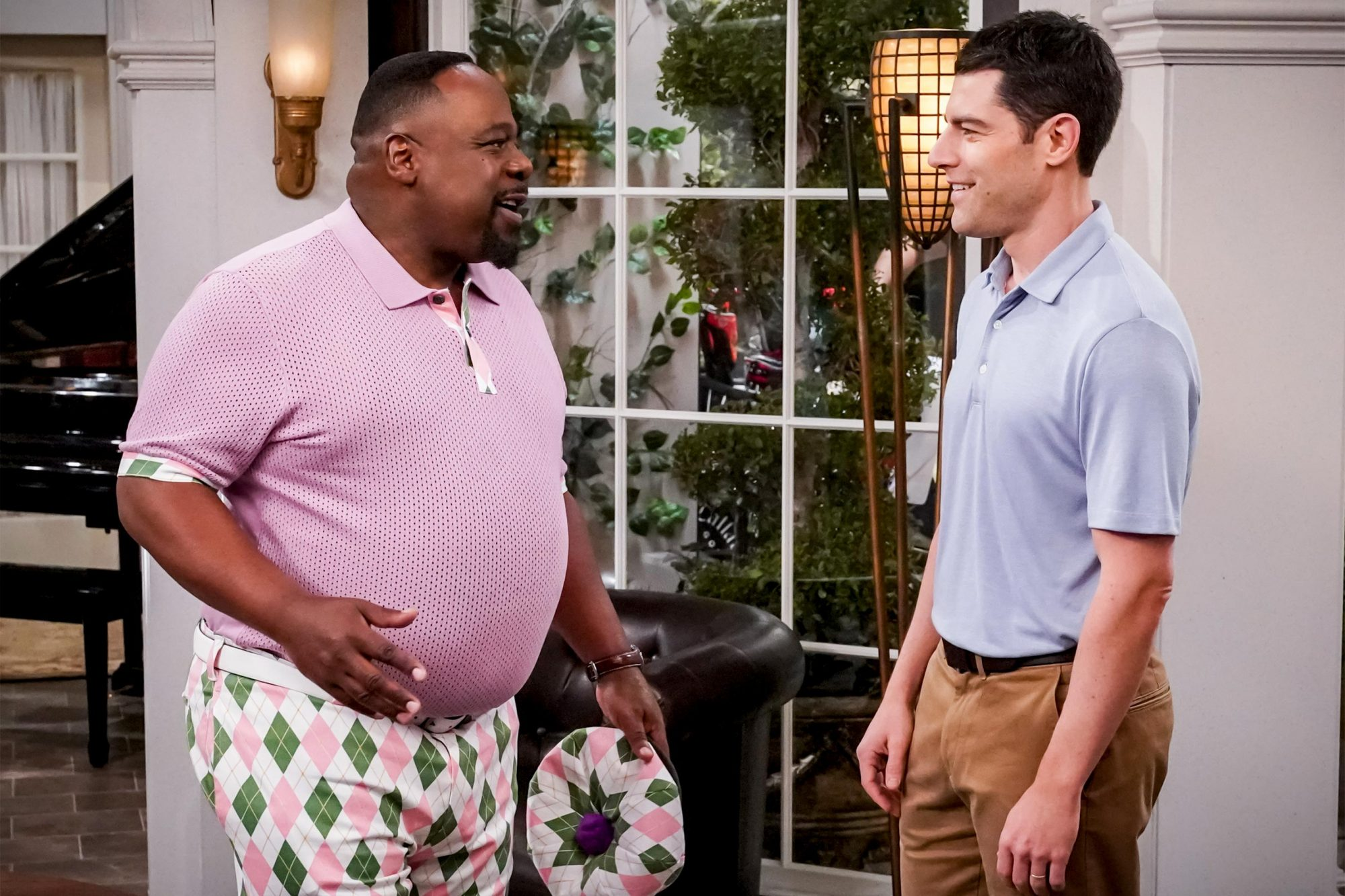 """""""Welcome to the Conversation"""" -- Pictured: Cedric the Entertainer (Calvin Butler) and Max Greenfield (Dave Johnson). Dave is thrilled when Calvin invites him golfing, confident that it represents progress in their relationship, but Calvin may have another motive. Also, Gemma and Tina team up to pull off an unforgettable surprise for Malcolm, Marty and Grover, on the first season finale of THE NEIGHBORHOOD, Monday, April 22 (8:00-8:30 PM, ET/PT) on the CBS Television Network. Photo: Monty Brinton/CBS ©2019 CBS Broadcasting, Inc. All Rights Reserved."""