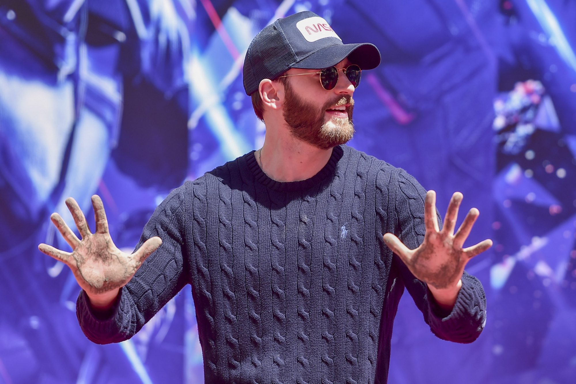 "HOLLYWOOD, CA - APRIL 23: Marvel Studios' ""Avengers: Endgame"" star Chris Evans at the Hand And Footprint Ceremony at the TCL Chinese Theatre on April 23, 2019 in Hollywood, California. (Photo by Alberto E. Rodriguez/Getty Images for Disney) *** Local Caption *** Chris Evans"