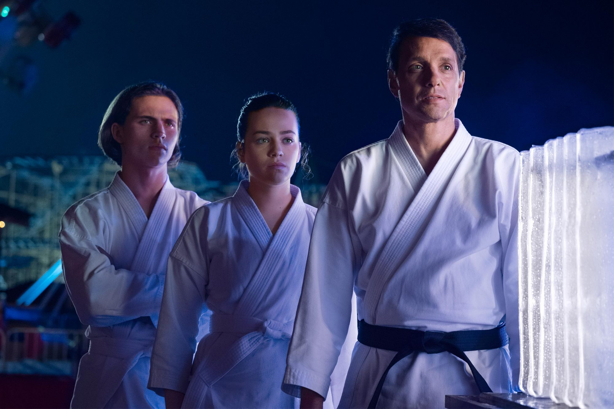 Cobra Kai Pictured: Tanner Buchanan, Mary Mouser, Ralph Macchio CR: Guy D'Alema/SONY