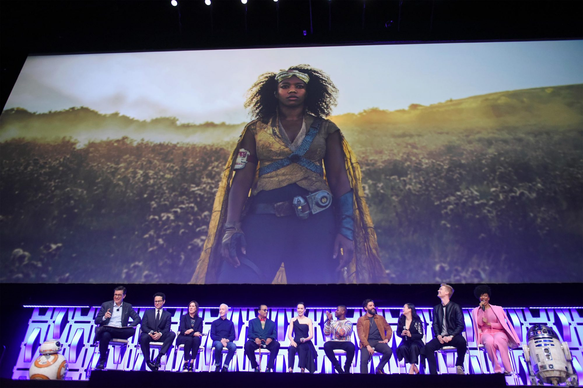 "CHICAGO, IL - APRIL 12: (L-R) BB-8, Moderator Stephen Colbert, Director J.J. Abrams, Producer Kathleen Kennedy, Anthony Daniels (C-3PO), Billy Dee Williams (Lando Calrissian), Daisy Ridley (Rey), John Boyega (Finn), Oscar Isaac (Poe Dameron), Kelly Marie Tran (Rose Tico), Joonas Suotamo (Chewbacca), Naomi Ackie (Jannah) and R2-D2 onstage during ""The Rise of Skywalker"" panel at the Star Wars Celebration at McCormick Place Convention Center on April 12, 2019 in Chicago, Illinois. (Photo by Daniel Boczarski/Getty Images for Disney )"